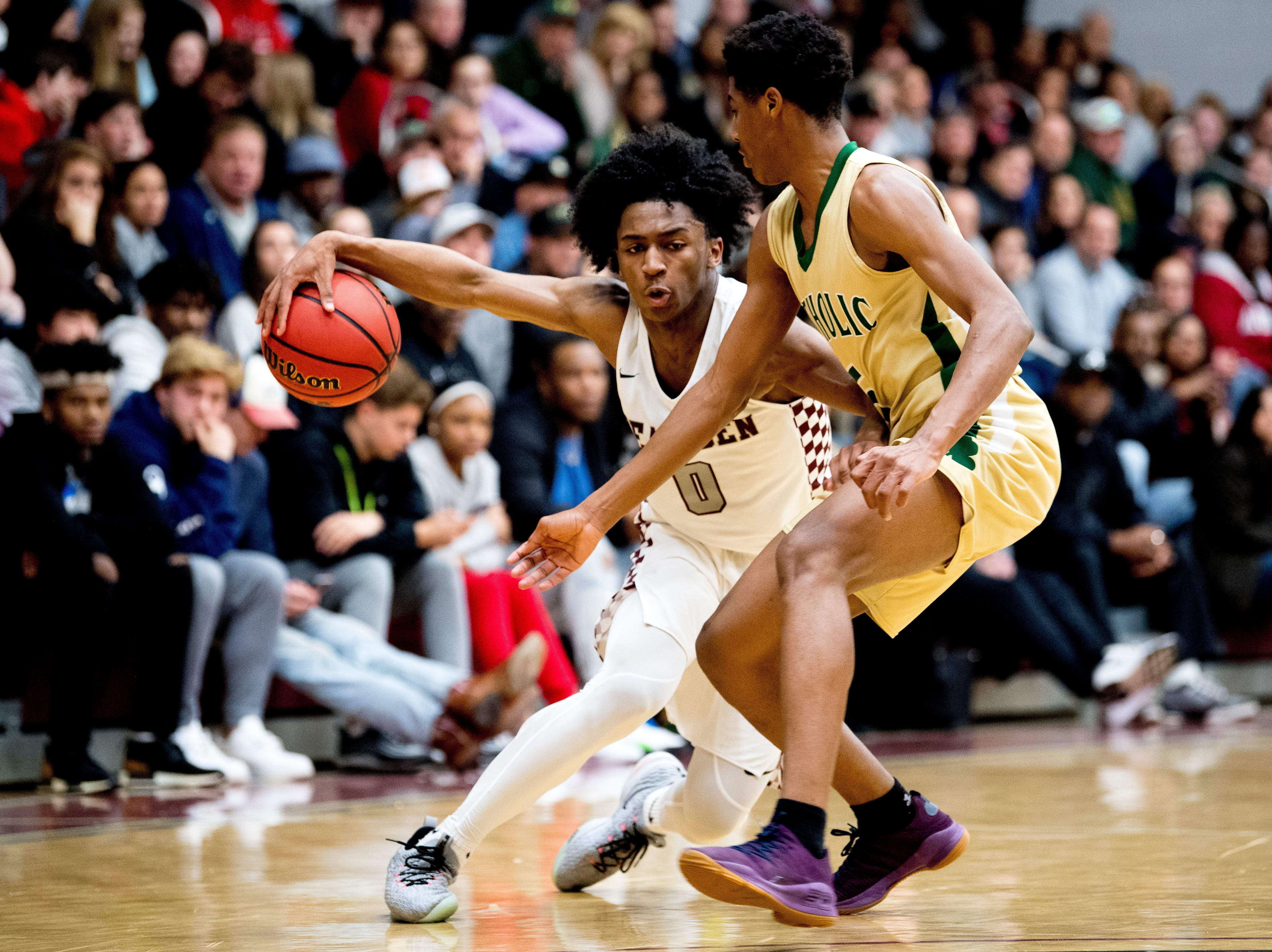 Bearden's Ques Glover (0) tries to dribble around Catholic's B.D. Edwards (5) during a game between Bearden and Catholic at Bearden High School in Knoxville, Tennessee on Thursday, January 10, 2019.