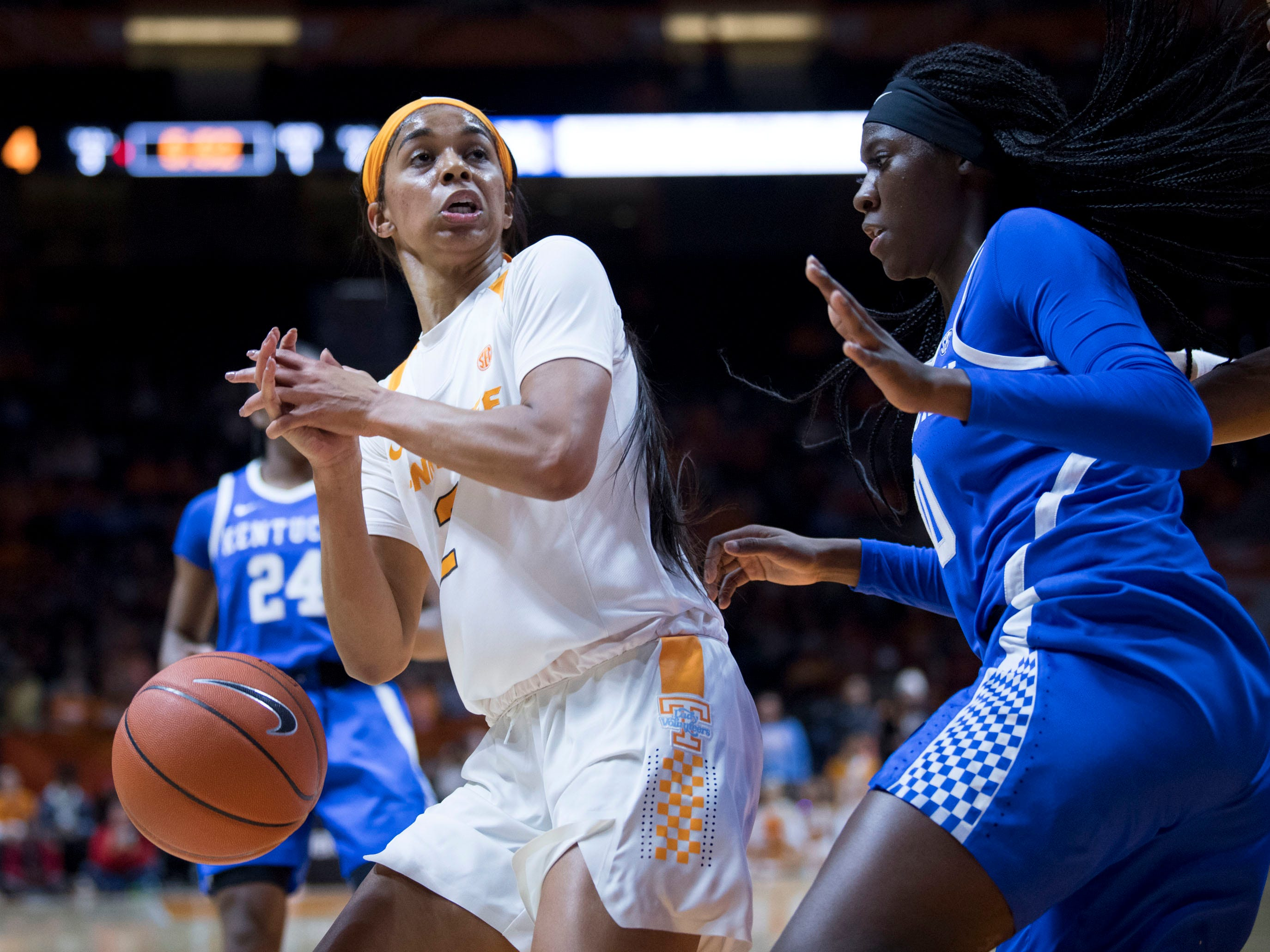 The ball slips out of the hands of Tennessee's Evina Westbrook (2) while she is guarded by Kentucky's Rhyne Howard (10) on Thursday, January 10, 2019.