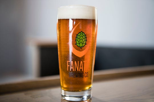 A beer by Fanatic Brewing sits on the bar of Fanatic's new tap room at their existing facility on North Central Street in Knoxville, Friday, Jan. 11, 2019. Velas hopes the tap room will open by this spring.