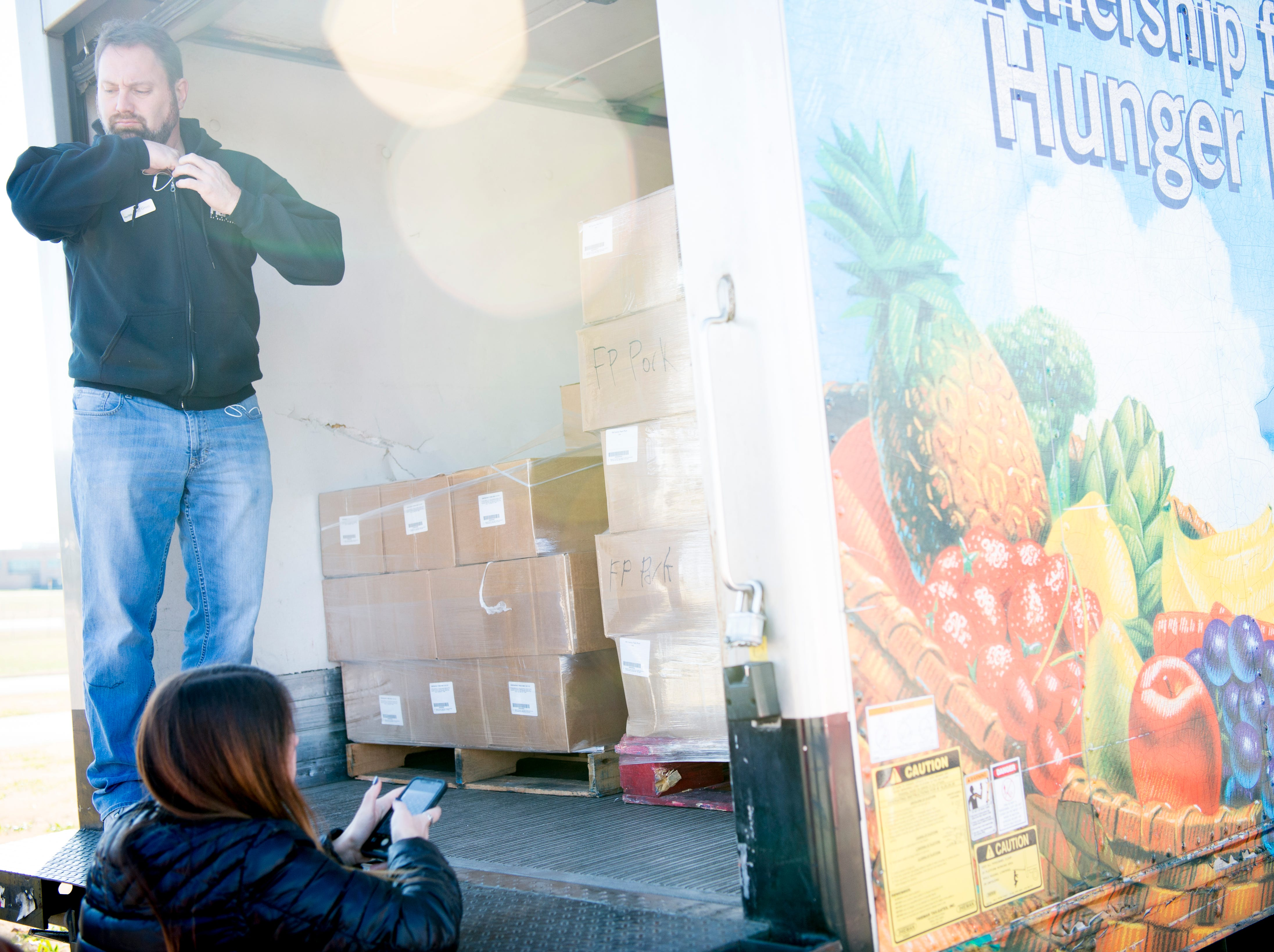 Jeff Gross, from Second Harvest Food Bank, prepares to unload meal boxes to TSA workers at McGhee Tyson Airport in Alcoa, Tennessee on Friday, January 11, 2019. Filling an 'unprecedented request,' Second Harvest Food Bank sent emergency food supplies to TSA workers.