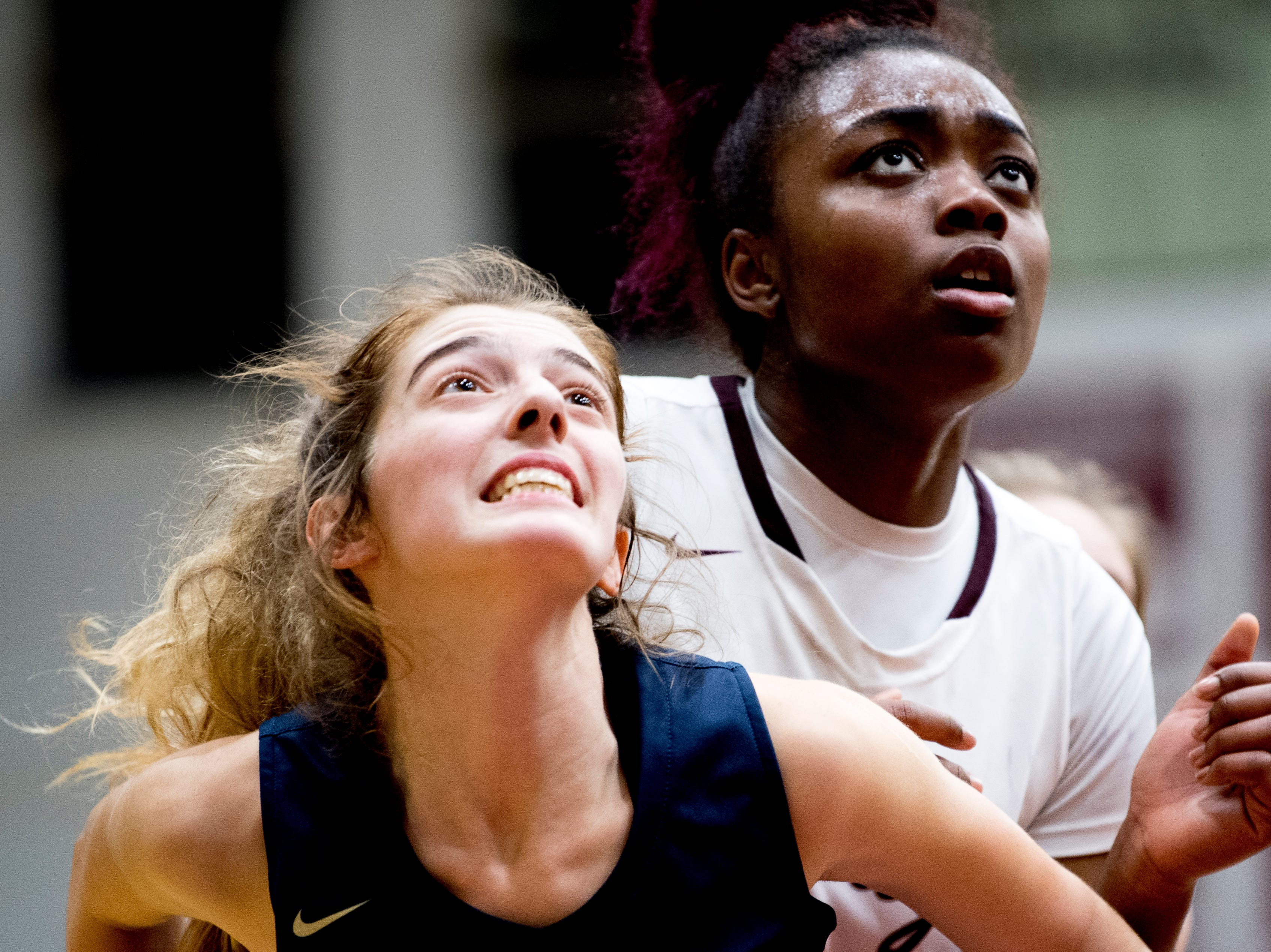 Bearden's Jakhyia Davis (42) and Catholic's Emily Pichiarella (30) eye the rebound ball during a game between Bearden and Catholic at Bearden High School in Knoxville, Tennessee on Thursday, January 10, 2019.