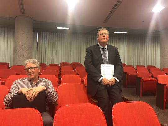 Patrick Birmingham (right) of Covenant Health awaits the outcome of a planning commission vote to establish a medical district around two hospitals in Fort Sanders on Jan. 10, 2019.