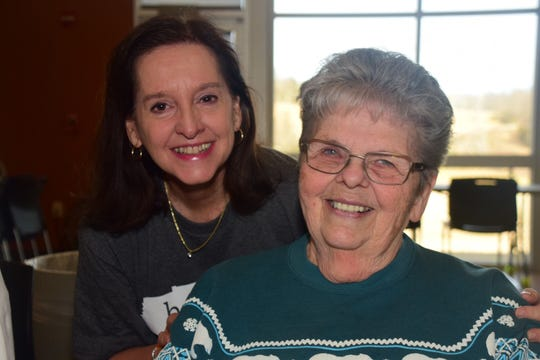 """Soprano Peggy Shaw says """"hello"""" to pal Betty Thompson who is attempting to sing tenor after singing soprano her whole life at choir practice at Karns Senior Center Friday, Jan 4."""
