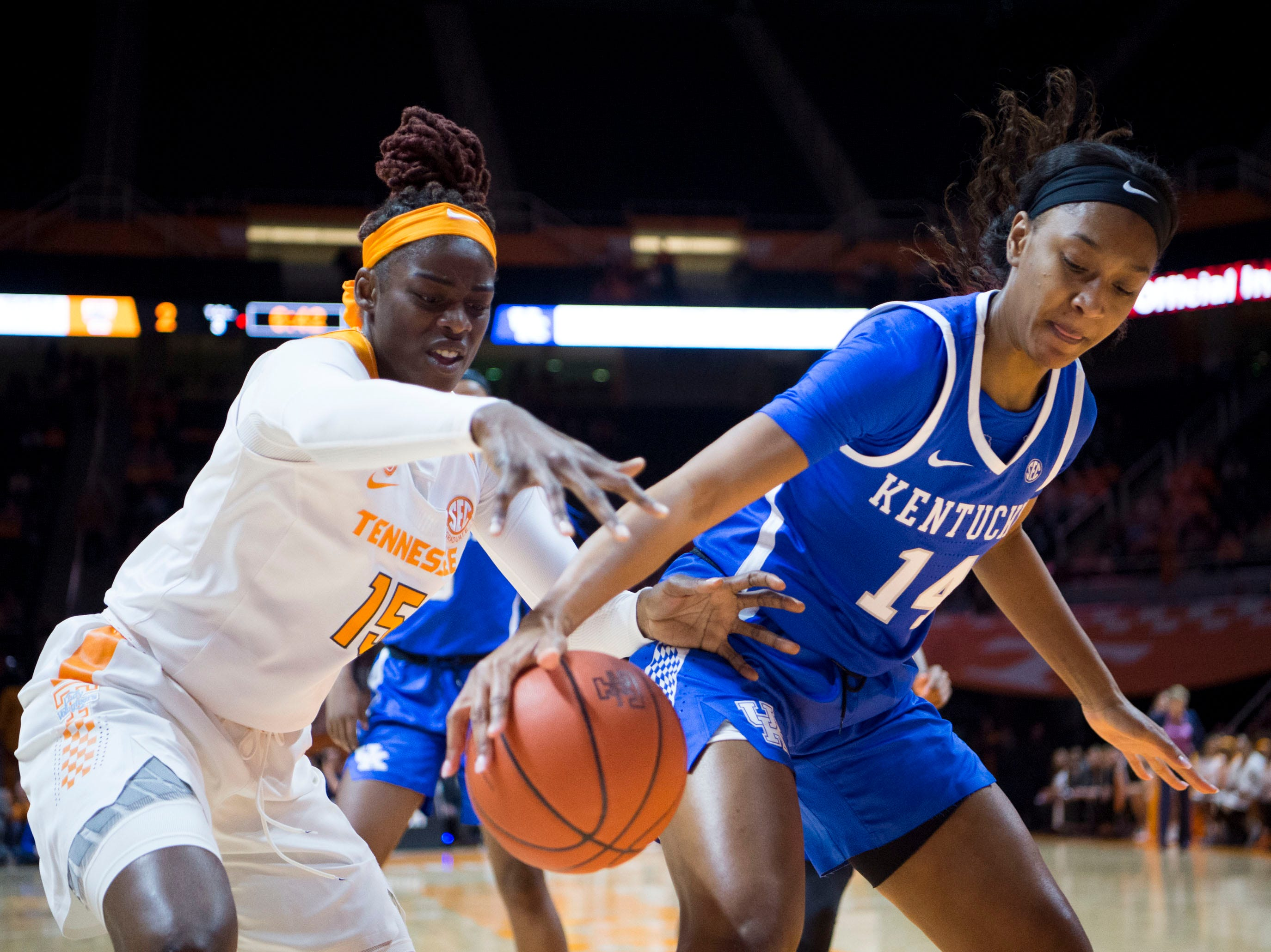 Kentucky's Tatyana Wyatt (14) tries to keep the ball from Tennessee's Cheridene Green (15) on Thursday, January 10, 2019.