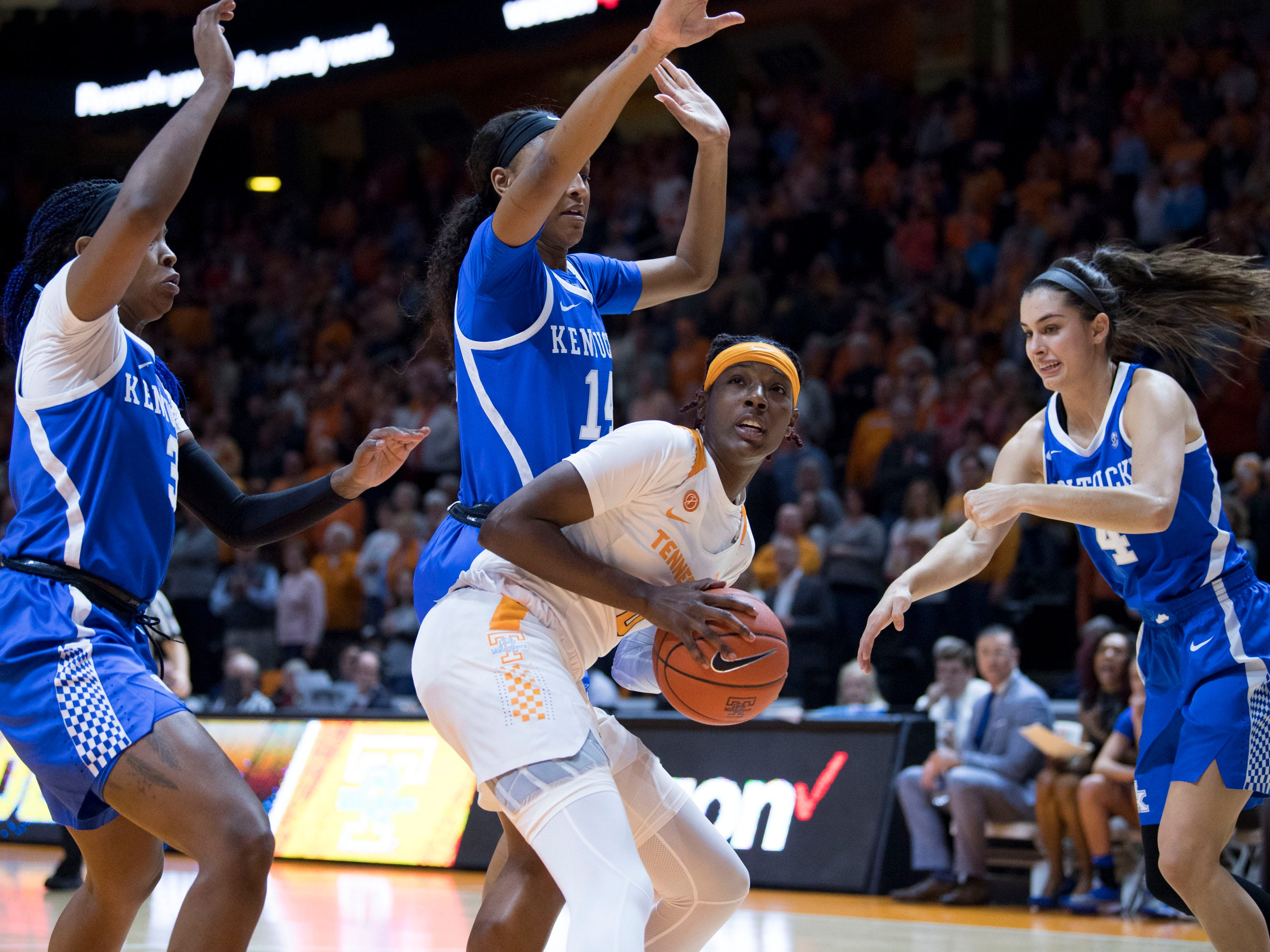 Tennessee's Rennia Davis (0) is guarded by Kentucky's KeKe McKinney (3), Tatyana Wyatt (14), and Maci Morris (4) on Thursday, January 10, 2019.