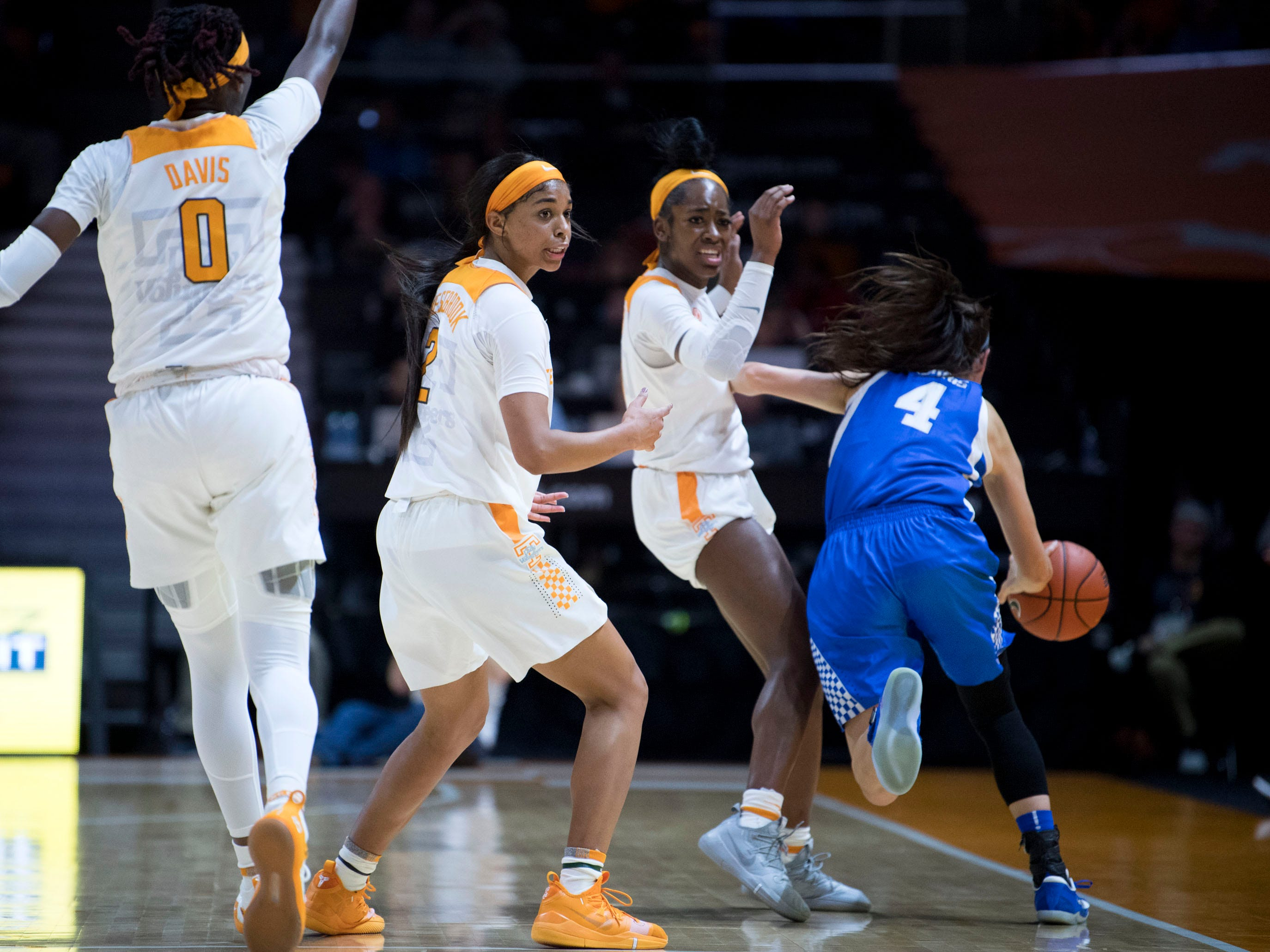 Tennessee's Evina Westbrook (2) and Zaay Green (14) looks to the officials for a call as Kentucky's Maci Morris (4) dribbles past on Thursday, January 10, 2019.