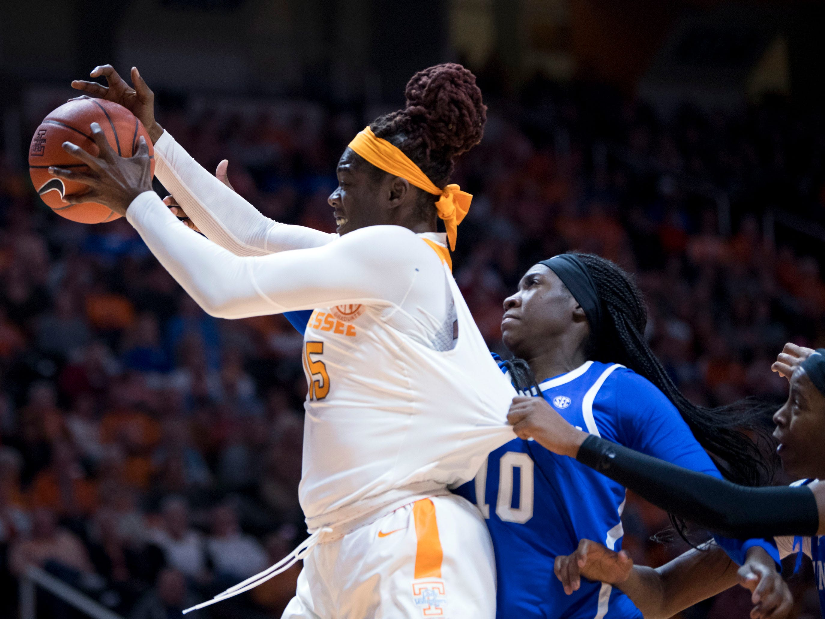 Tennessee's Cheridene Green (15) gets the rebound over Kentucky's Rhyne Howard (10) on Thursday, January 10, 2019.