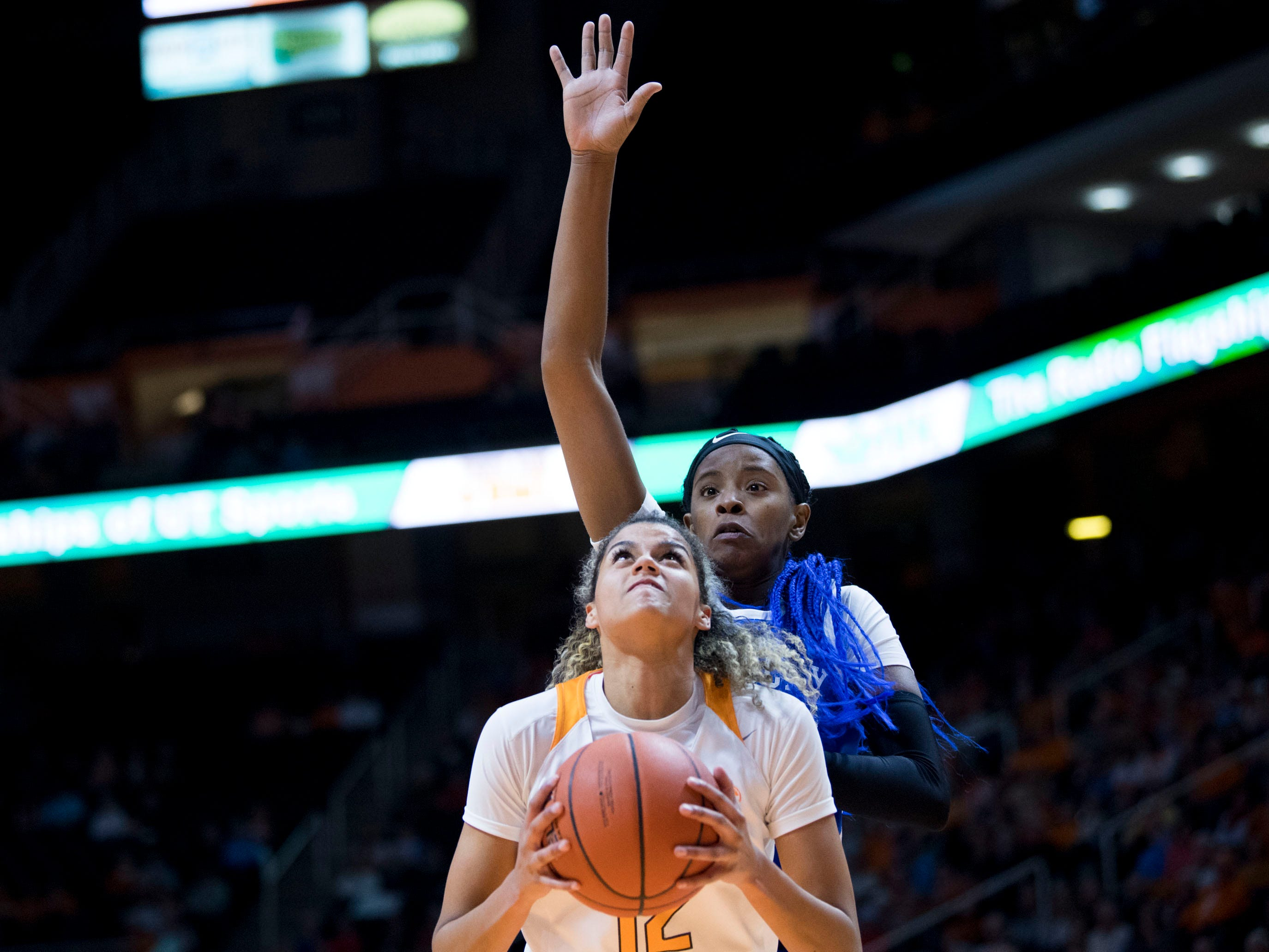 Tennessee's Rae Burrell (12) looks to the basket while guarded by Kentucky's KeKe McKinney (3) on Thursday, January 10, 2019.