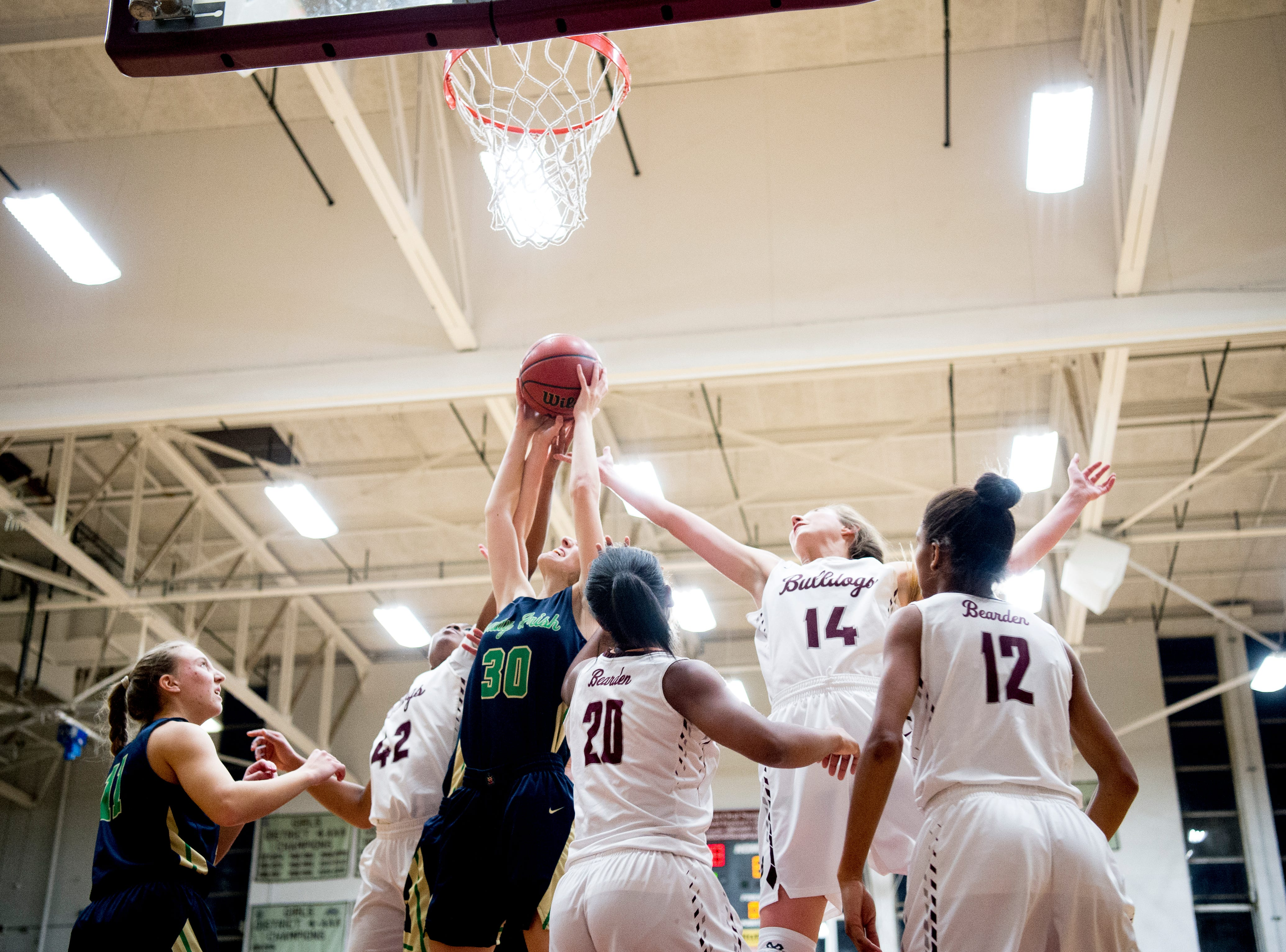 Catholic's Emily Pichiarella (3) grabs the rebound ball as Bearden's Annaka Hall (14) defends during a game between Bearden and Catholic at Bearden High School in Knoxville, Tennessee on Thursday, January 10, 2019.