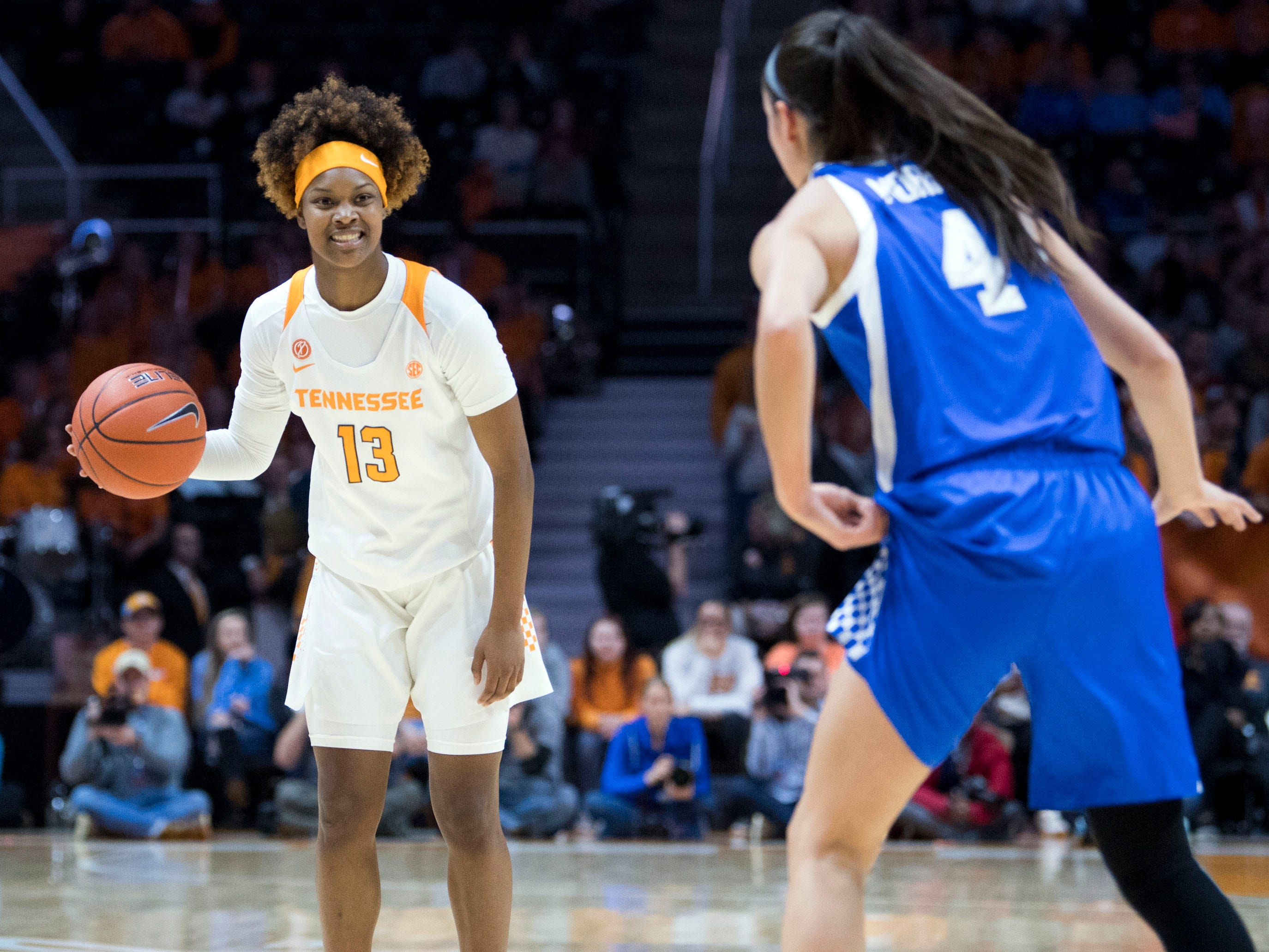 Tennessee's Jazmine Massengill (13) smiles as Kentucky's Maci Morris (4) approaches on Thursday, January 10, 2019.