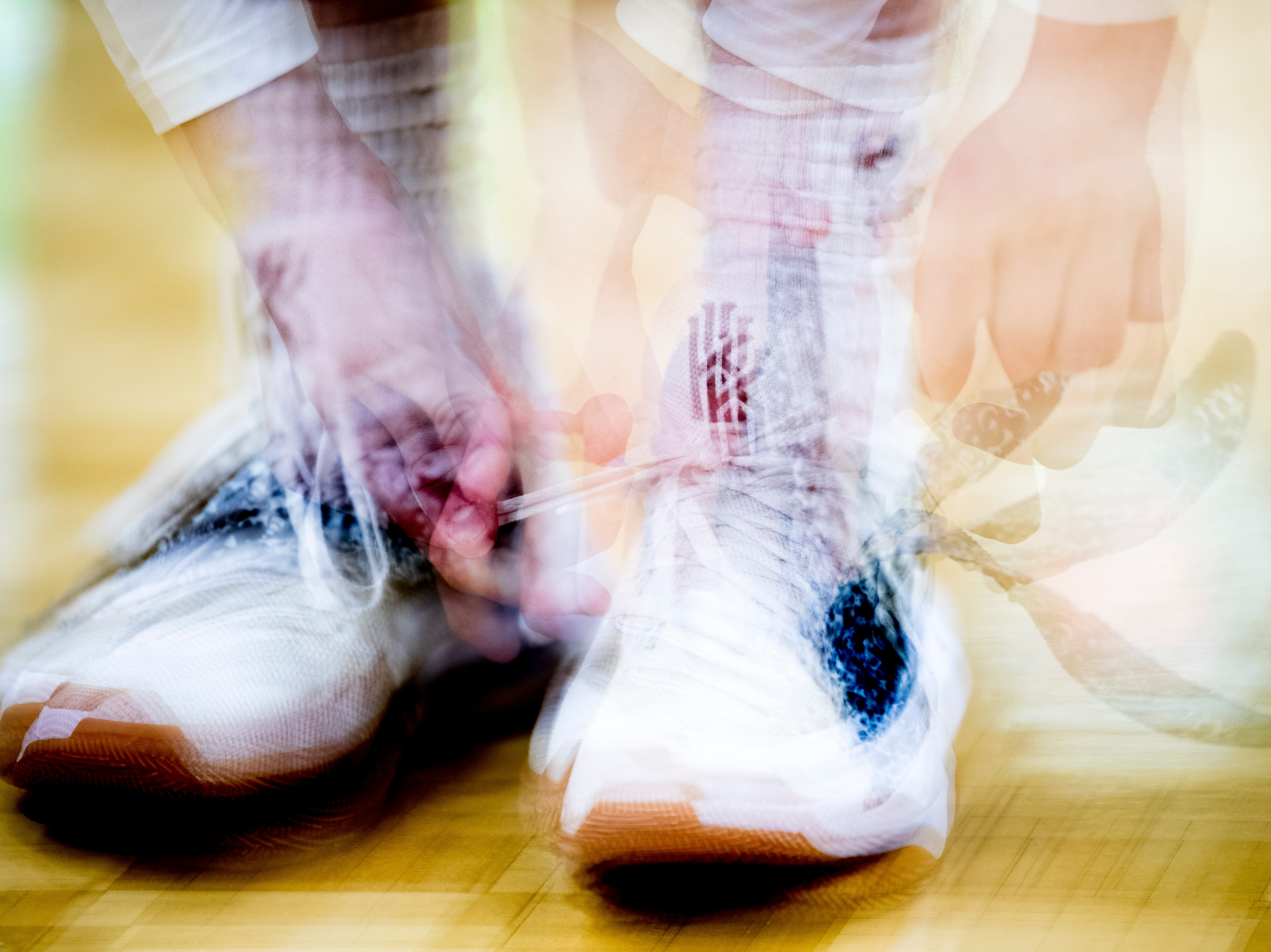 A Bearden player fastens their shoes during a game between Bearden and Catholic at Bearden High School in Knoxville, Tennessee on Thursday, January 10, 2019.