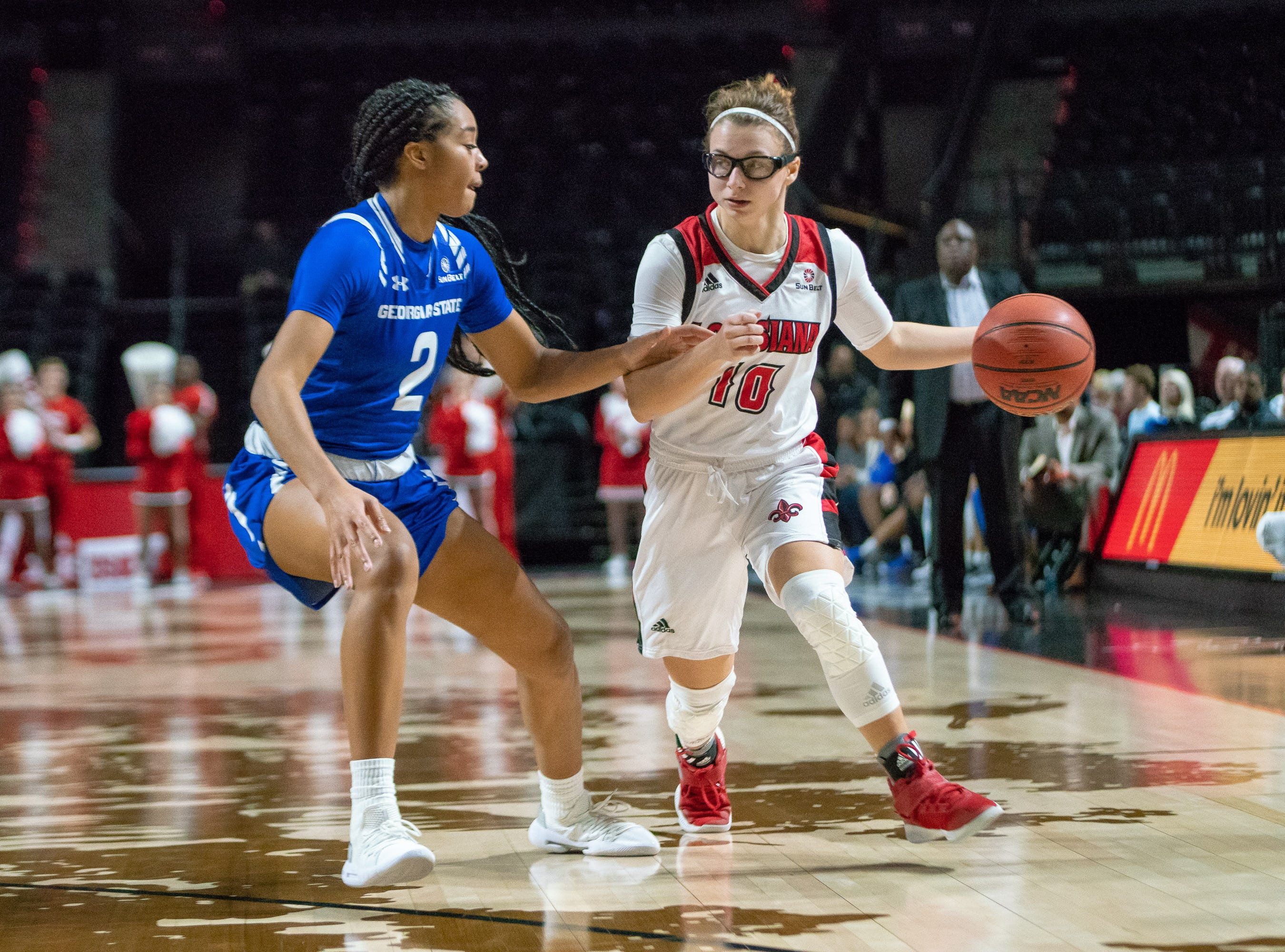 UL's Andrea Cournoyer moves the ball down the court as the Ragin' Cajuns play against the Georgia State Panthers at the Cajundome on January 10, 2019.