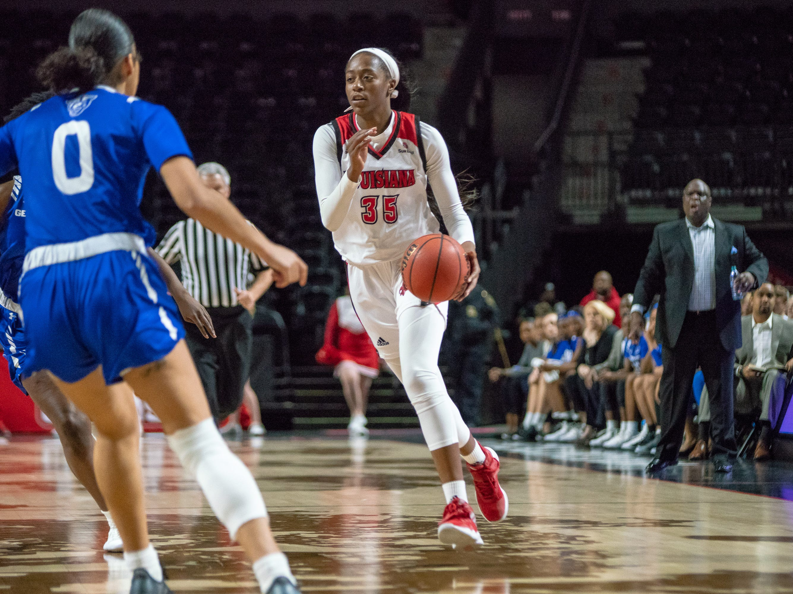 UL's Ty'Reona Doucet dribbles the ball down the court as the Ragin' Cajuns play against the Georgia State Panthers at the Cajundome on January 10, 2019.