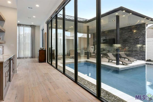 There are views of the outdoor pool from every room.