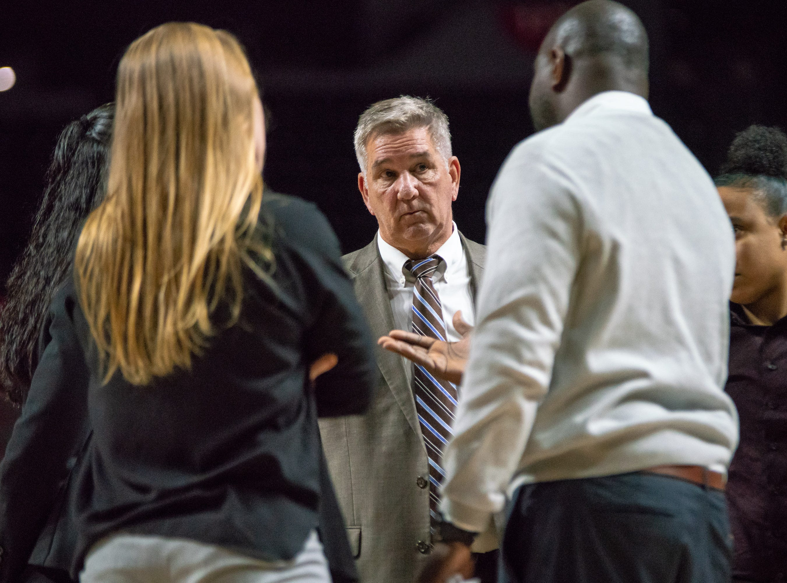 UL's head coach Garry Brodhead talks to his coaches during a time-out as the Ragin' Cajuns play against the Georgia State Panthers at the Cajundome on January 10, 2019.
