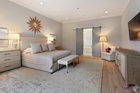 The master suite and bath are fit for royalty.