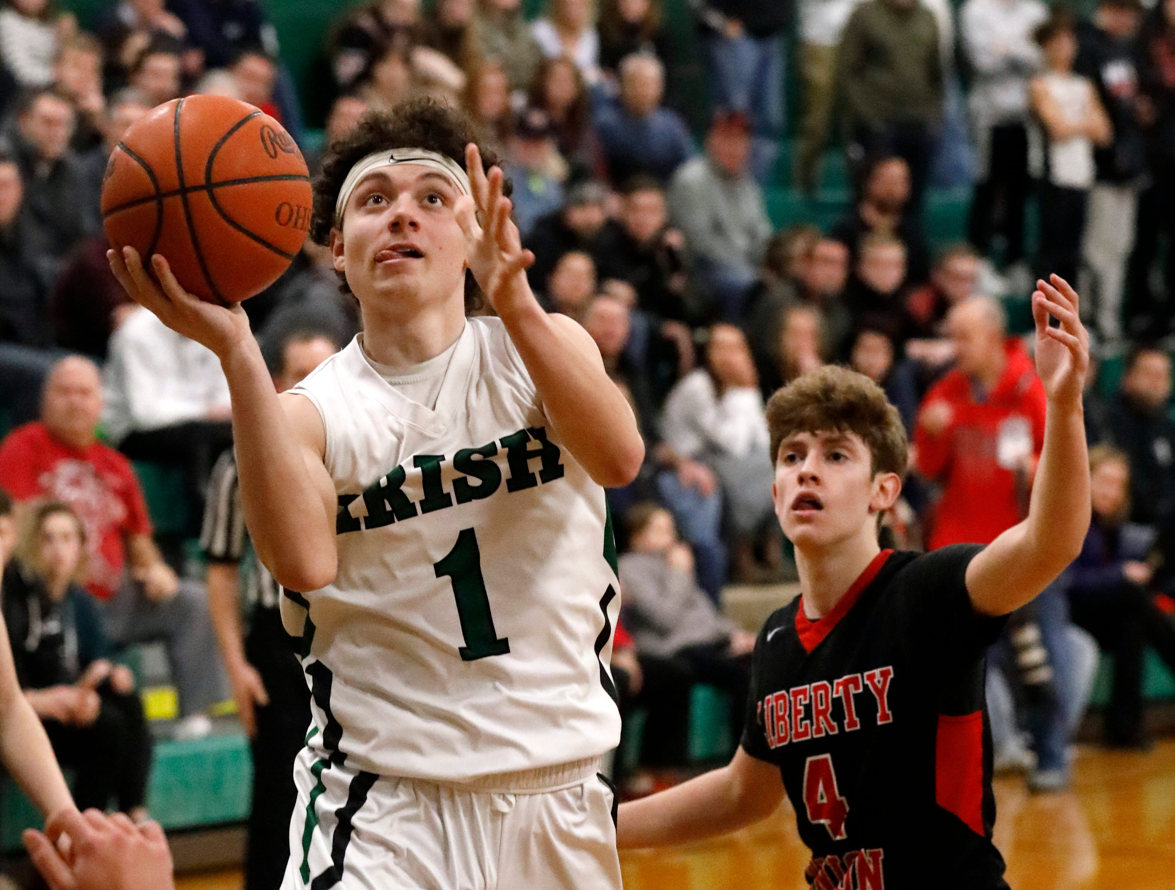 Fisher Catholic's Peyton Shockley goes in for a layup during Thursday night's game, Jan. 10, 2019, at Fisher Catholic High School in