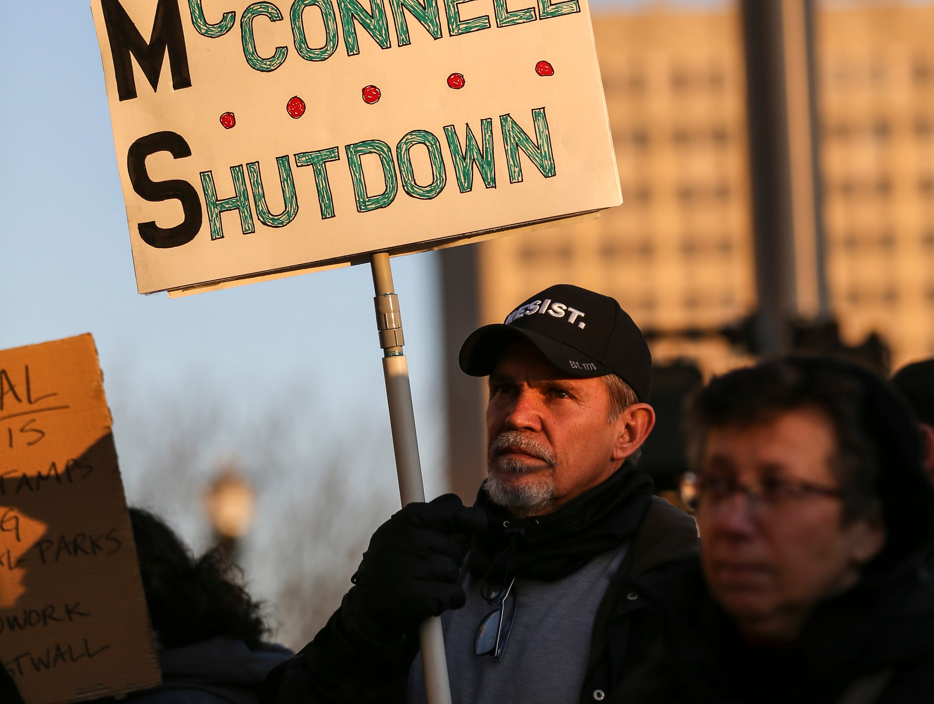 Frustrated federal employees of the government shutdown chanted 'End it now' and 'We want to work' outside Senate Majority leader Mitch McConnell's office Thursday afternoon in Louisville. January 10, 2019