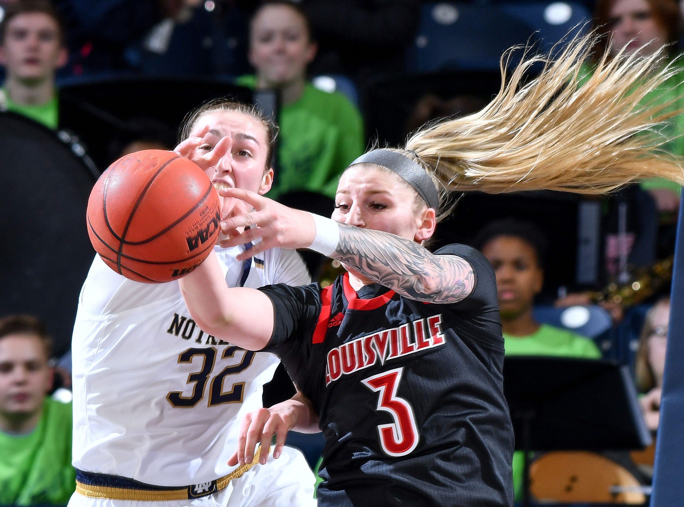 Jan 10, 2019; South Bend, IN, USA; Notre Dame Fighting Irish forward Jessica Shepard (32) and Louisville Cardinals forward Sam Fuehring (3) reach for a rebound in the first half at the Purcell Pavilion.