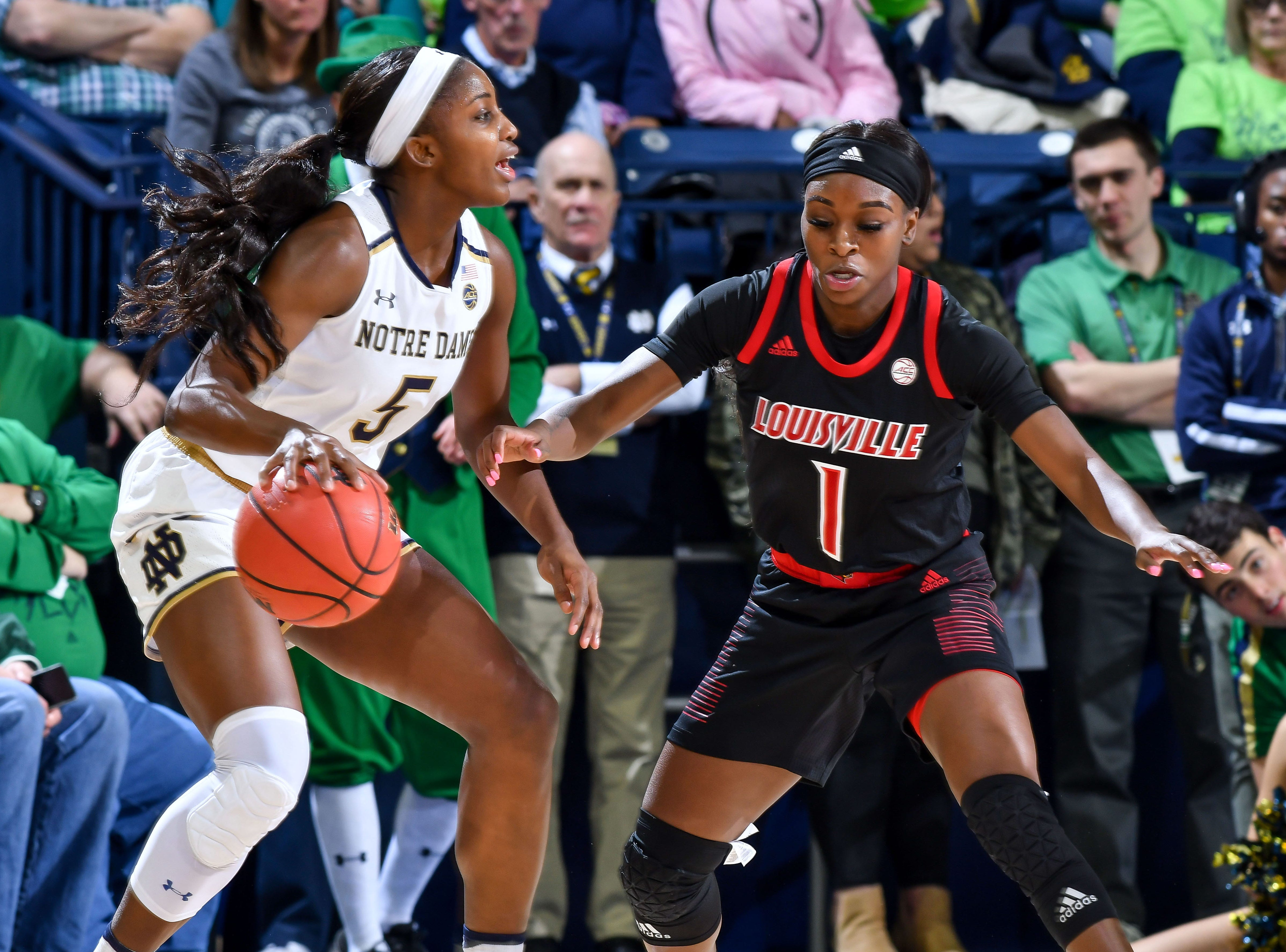 Jan 10, 2019; South Bend, IN, USA; Notre Dame Fighting Irish guard Jackie Young (5) dribbles as Louisville Cardinals guard Dana Evans (1) defends in the first half at the Purcell Pavilion.