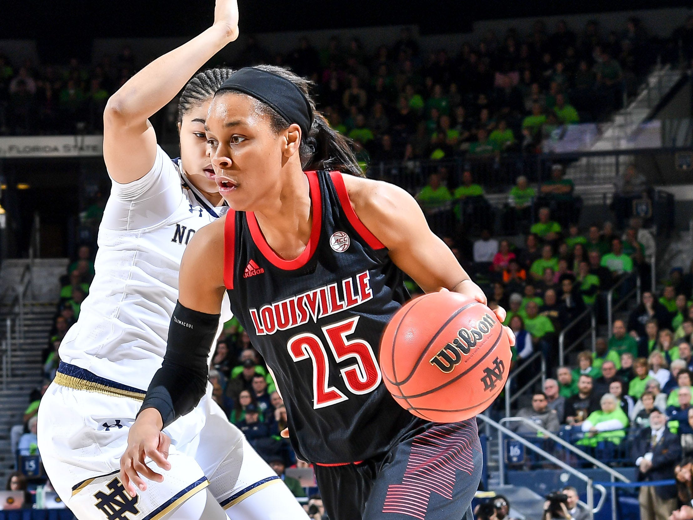 Jan 10, 2019; South Bend, IN, USA; Louisville Cardinals guard Asia Durr (25) drives to the basket as Notre Dame Fighting Irish guard Jordan Nixon (0) defends in the first half at the Purcell Pavilion.