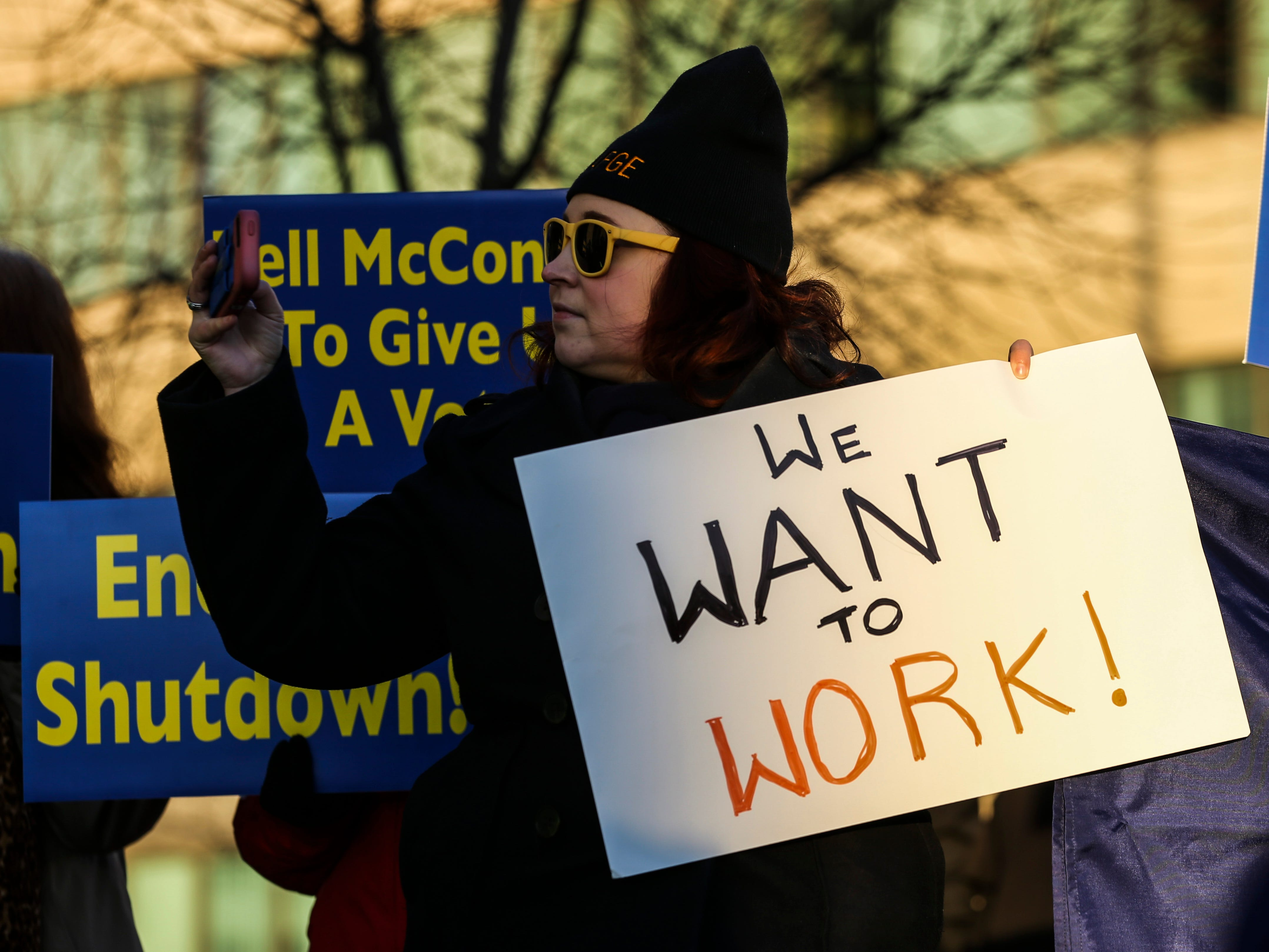 Frustrated federal employees of the government shutdown chanted 'End it now' and 'We want to work' outside Senate Majority leader Mitch McConnell's office Thursday afternoon.  January 10, 2019