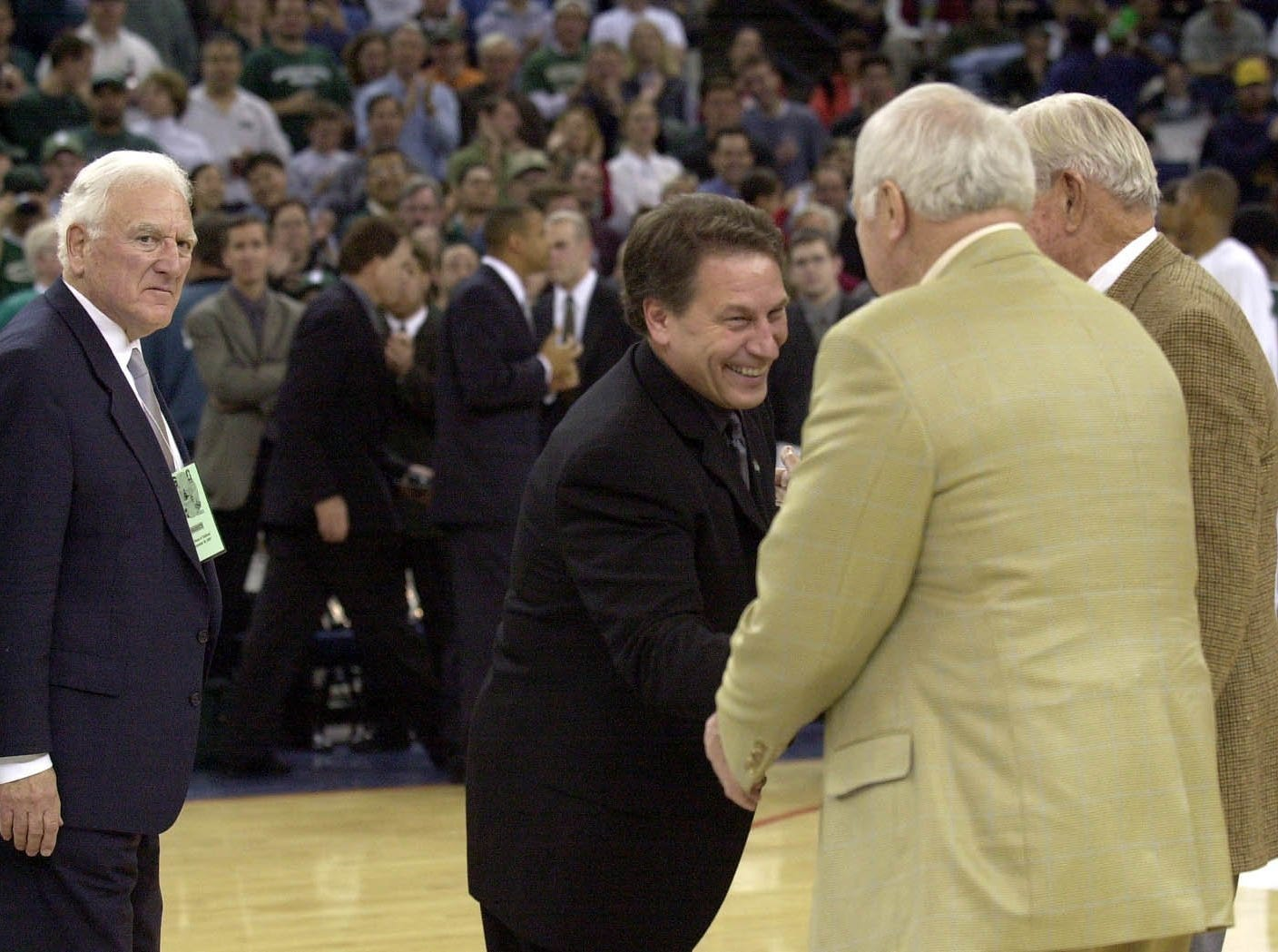 Current MSU basketball coach Tom Izzo, center, shakes hands with former MSU coaches Gus Ganakas, Jud Heathcote and Pete Newell, left to right, in Oakland, Ca, Saturday night before the Spartans' basketball game against Stanford in the Pete Newell Challenge.