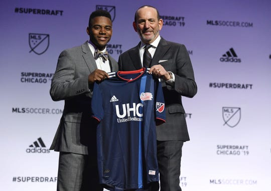 DeJuan Jones greets MLS commissioner Don Garber after being selected as the number eleven overall pick to the New England Revolution in the first round of the 2019 MLS Super Draft at McCormick Place.