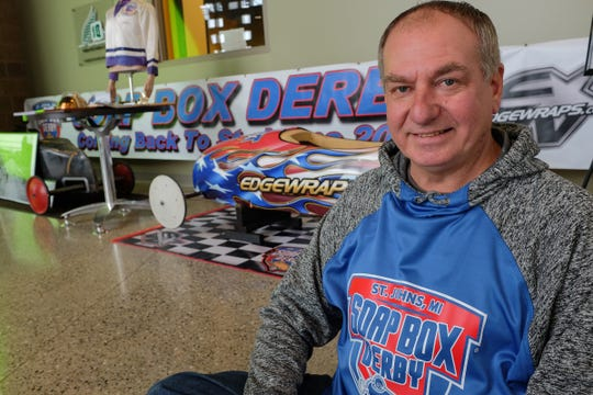 Dan Matson is the race director for the upcoming St. Johns Soap Box Derby to be held on Fathers Day. Matson is excited to bring back the race to St. Johns after a 43-year hiatus. Here, he is pictured with a display at the AgroLiquid building Thursday, Jan. 10, 2019.