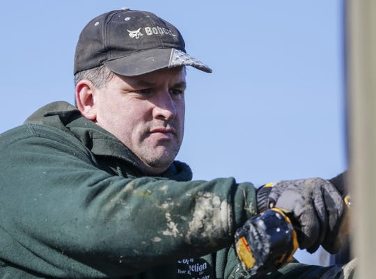 Bruce Robinson connects wall sections together on a new raptor cage for Wildlife of Wisconsin rehabilitators Saturday, November 10, 2018, in Cato, Wis. Robinson organized the volunteer effort between the drug court and WOW. Joshua Clark/USA TODAY NETWORK-Wisconsin