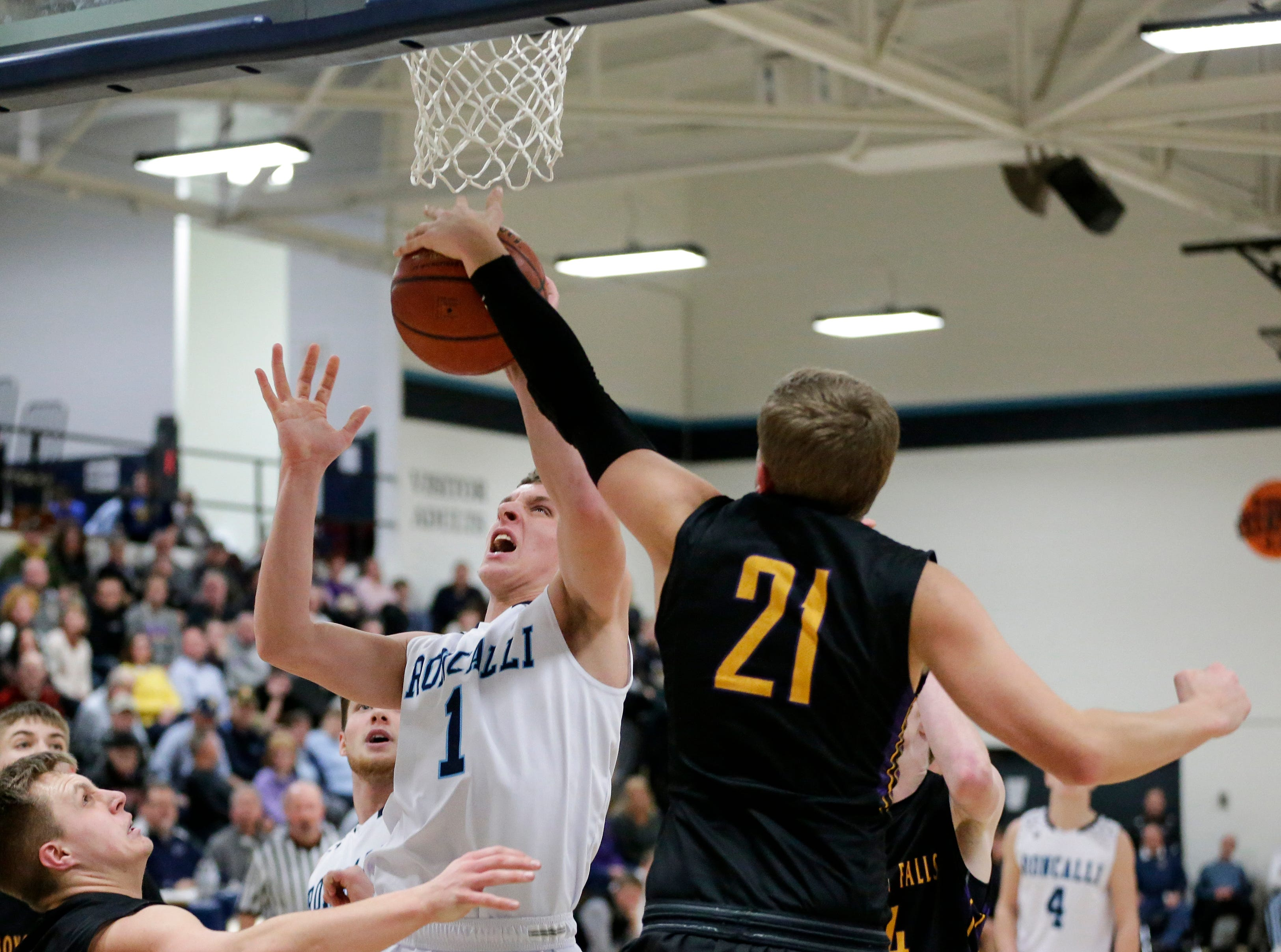 Sheboygan Falls' Connor Spielvogel blocks a shot by Roncalli's Daniel Burgarino during an EWC matchup at Roncalli High School Thursday, January 10, 2019, in Manitowoc, Wis. Joshua Clark/USA TODAY NETWORK-Wisconsin