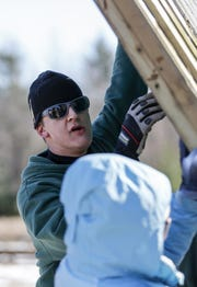 """Brian Robinson, of the Manitowoc County Drug Court, helps put up a wall for a new raptor cage for Wildlife of Wisconsin rehabilitators Saturday, November 10, 2018, in Cato, Wis. """"Getting to do something like this is pretty neat because it's giving back,"""" Robinson said. """"Actually getting together and all of us accomplishing something on this type of scale is. We haven't gotten that opportunity yet so it's nice to bond with each other and just to see something big get done."""" Joshua Clark/USA TODAY NETWORK-Wisconsin"""