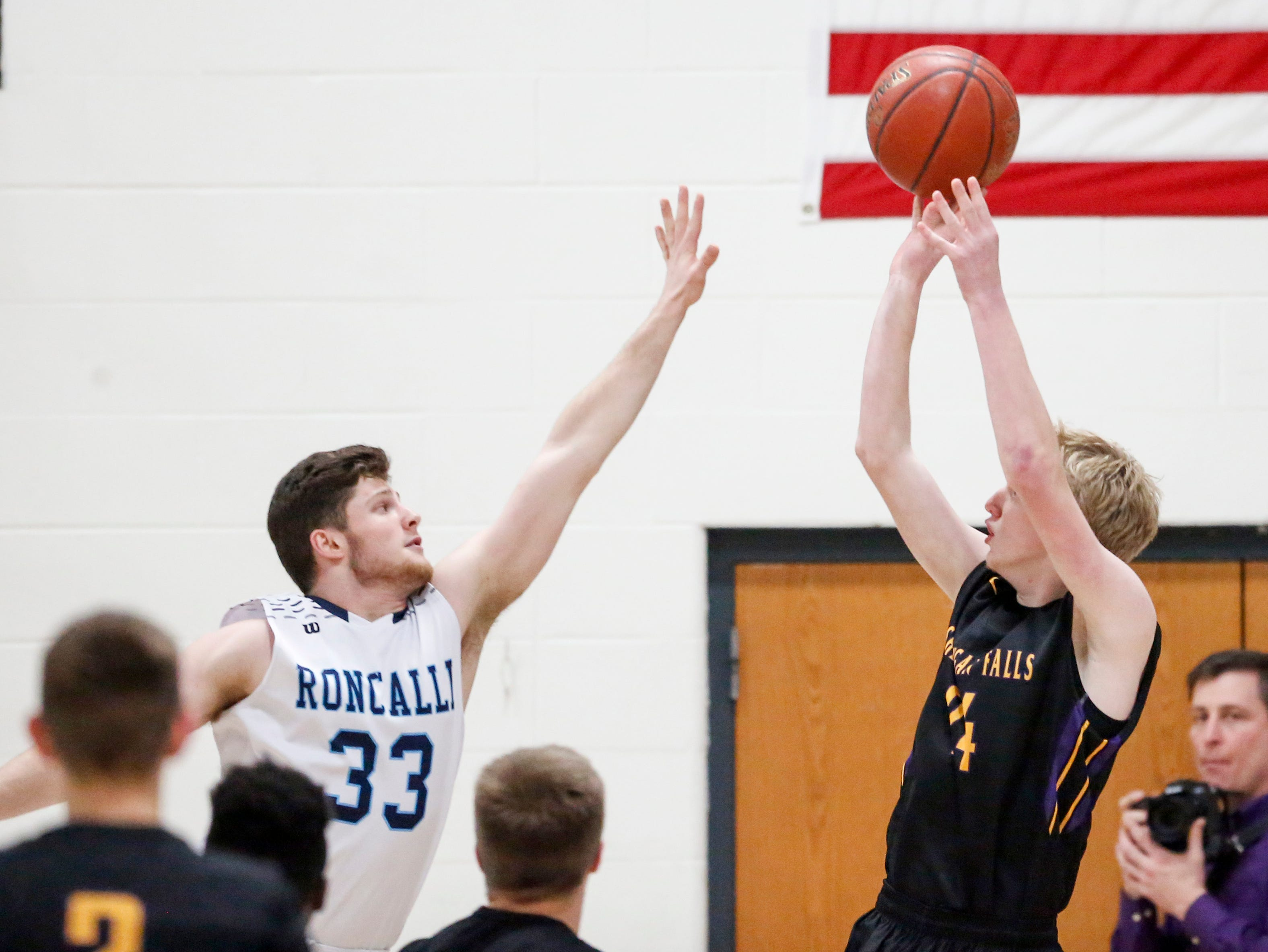 Sheboygan Falls' Isaac Klemme (24) shoots against Roncalli's David Heinzen during an EWC matchup at Roncalli High School Thursday, January 10, 2019, in Manitowoc, Wis. Joshua Clark/USA TODAY NETWORK-Wisconsin