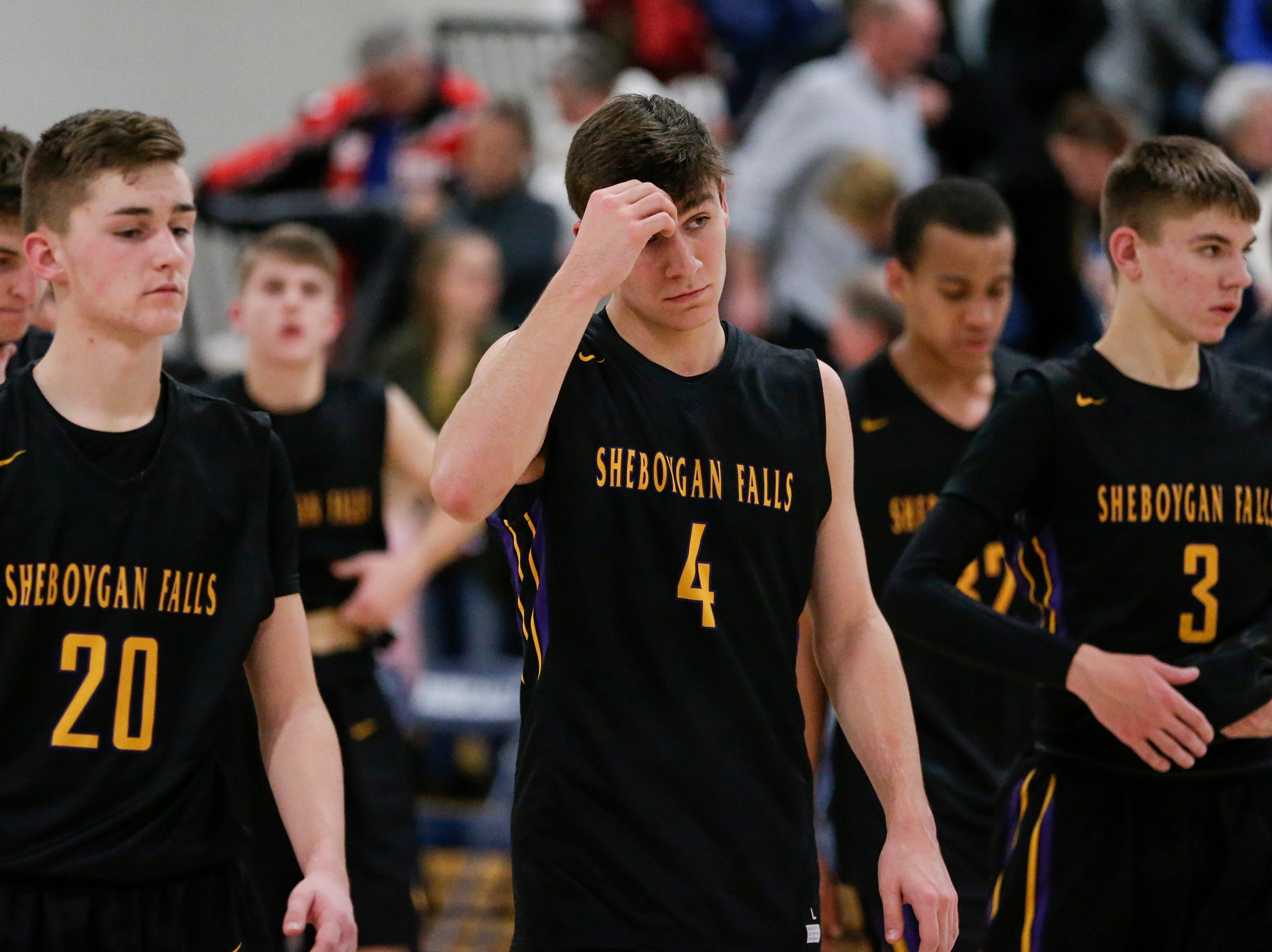 Sheboygan Falls walks back to the locker room after losing their first conference game of the season to Roncalli 72-35 at Roncalli High School Thursday, January 10, 2019, in Manitowoc, Wis. Joshua Clark/USA TODAY NETWORK-Wisconsin