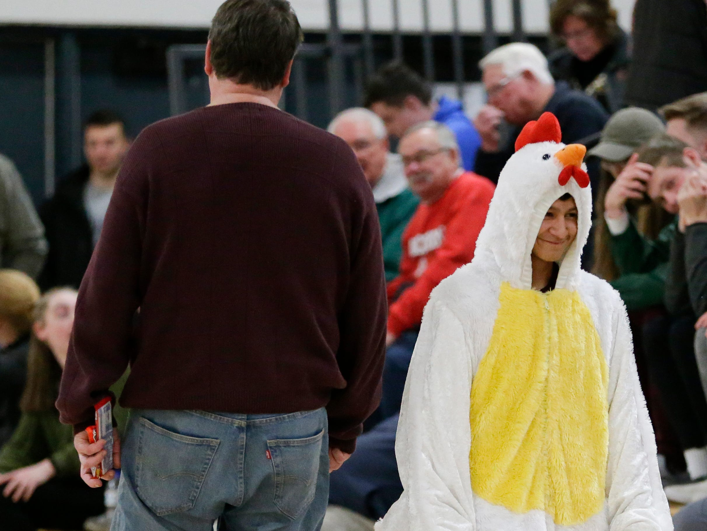 A Roncalli student dressed as a chicken walks to his seat during an EWC matchup against Sheboygan Falls at Roncalli High School Thursday, January 10, 2019, in Manitowoc, Wis. Joshua Clark/USA TODAY NETWORK-Wisconsin