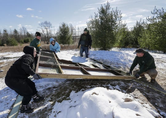 Volunteers, some participants of the Manitowoc County drug court, work to erect a new raptor cage for Wildlife of Wisconsin rehabilitators Saturday, November 10, 2018, in Cato, Wis. Joshua Clark/USA TODAY NETWORK-Wisconsin