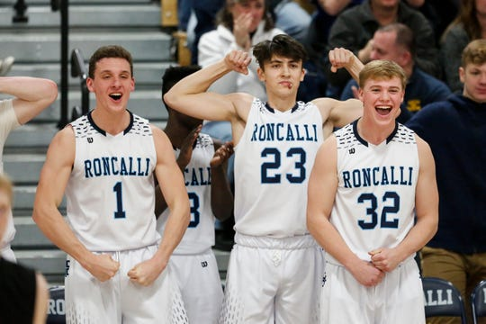 Roncalli's Daniel Burgarino, Jack Beckner and Connor Jacoby react to a shot against Sheboygan Falls in the final minutes of the game at Roncalli High School on Thursday in Manitowoc.