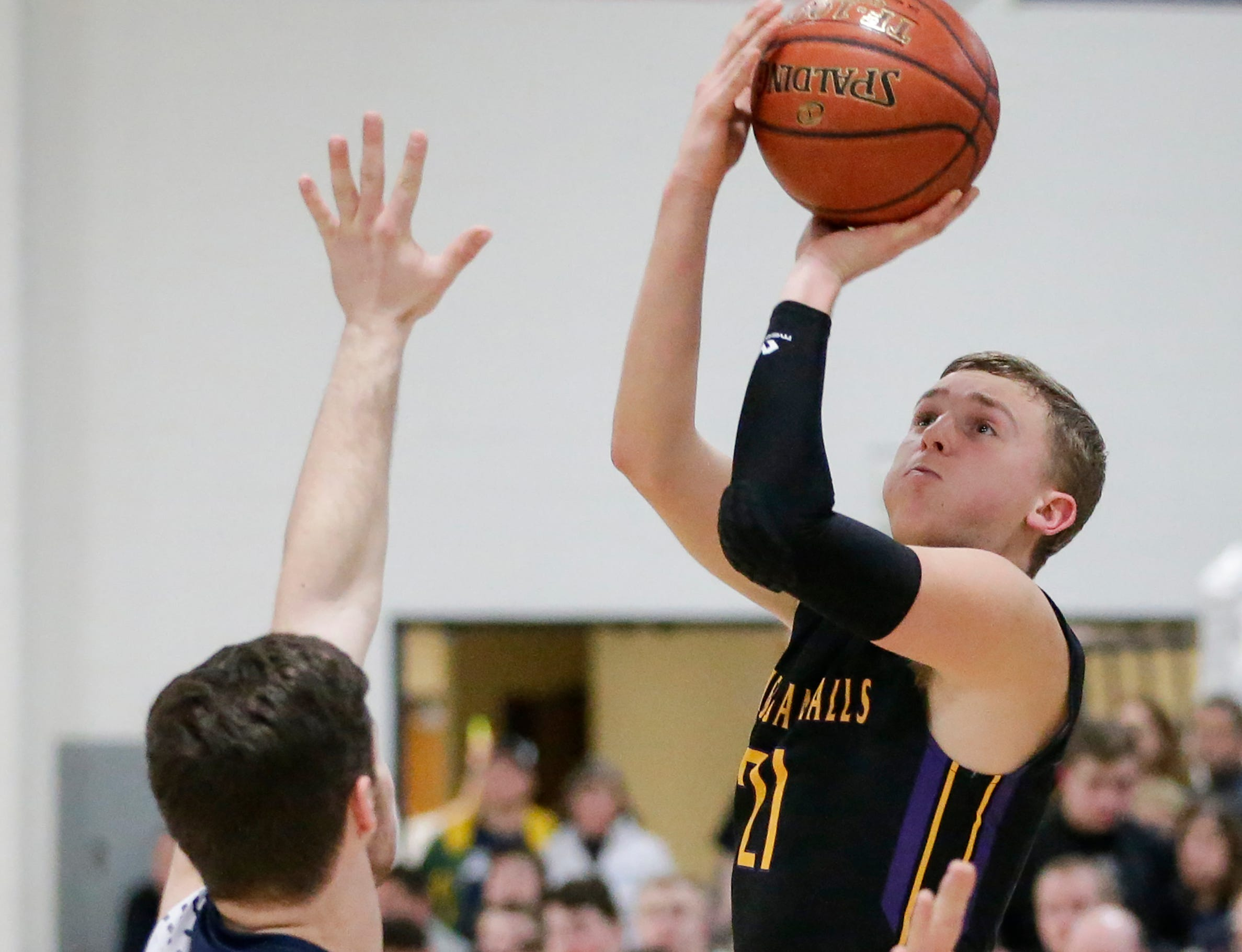 Sheboygan Falls' Connor Spielvogel (21) shoots against Roncalli during an EWC matchup at Roncalli High School Thursday, January 10, 2019, in Manitowoc, Wis. Joshua Clark/USA TODAY NETWORK-Wisconsin