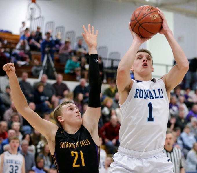 Roncalli's Daniel Burgarino shoots past Sheboygan Falls's Connor Spielvogel during an EWC matchup at Roncalli High School Thursday, January 10, 2019, in Manitowoc, Wis. Joshua Clark/USA TODAY NETWORK-Wisconsin