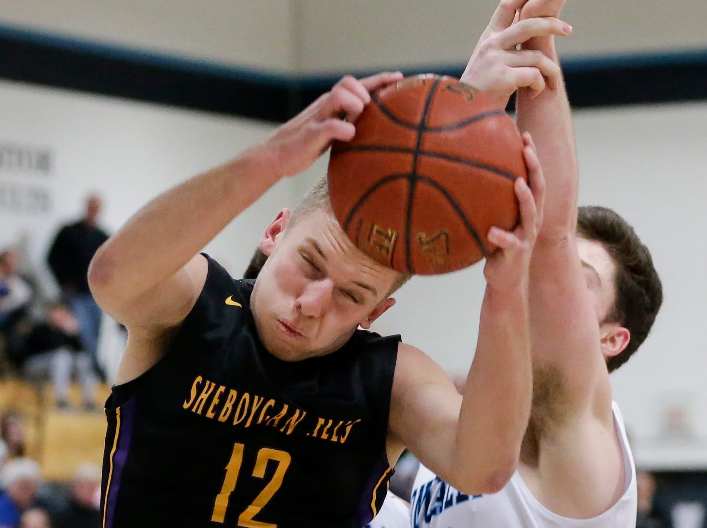 Sheboygan Falls' Langdon Thiel rebounds against Roncalli during an EWC matchup at Roncalli High School Thursday, January 10, 2019, in Manitowoc, Wis. Joshua Clark/USA TODAY NETWORK-Wisconsin