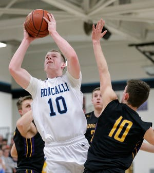 Manitowoc Roncalli's Matthew Le Ven drives to the hoop against Sheboygan Falls' Justin Tenpas during a Jan. 10 game in Manitowoc. Roncalli is the top-ranked team in the G10 coverage area.