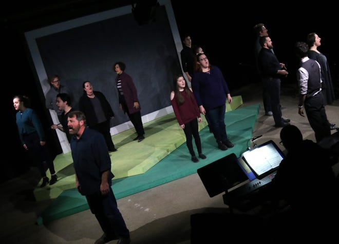 """Cast members of the Theatre 166 production of """"Sunday in the Park with George"""" rehearse a scene."""