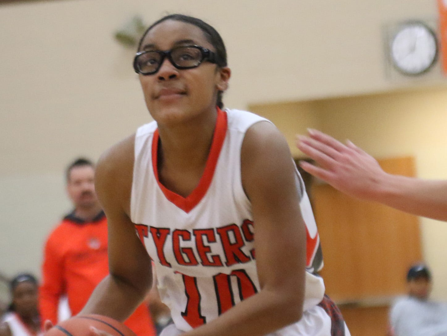 Mansfield Senior's DaKiyah White looks to make a basket while playing against Madison on Thursday.