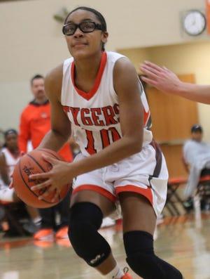 Mansfield Senior's DaKiyah White looks to make a basket while playing against Madison last week.