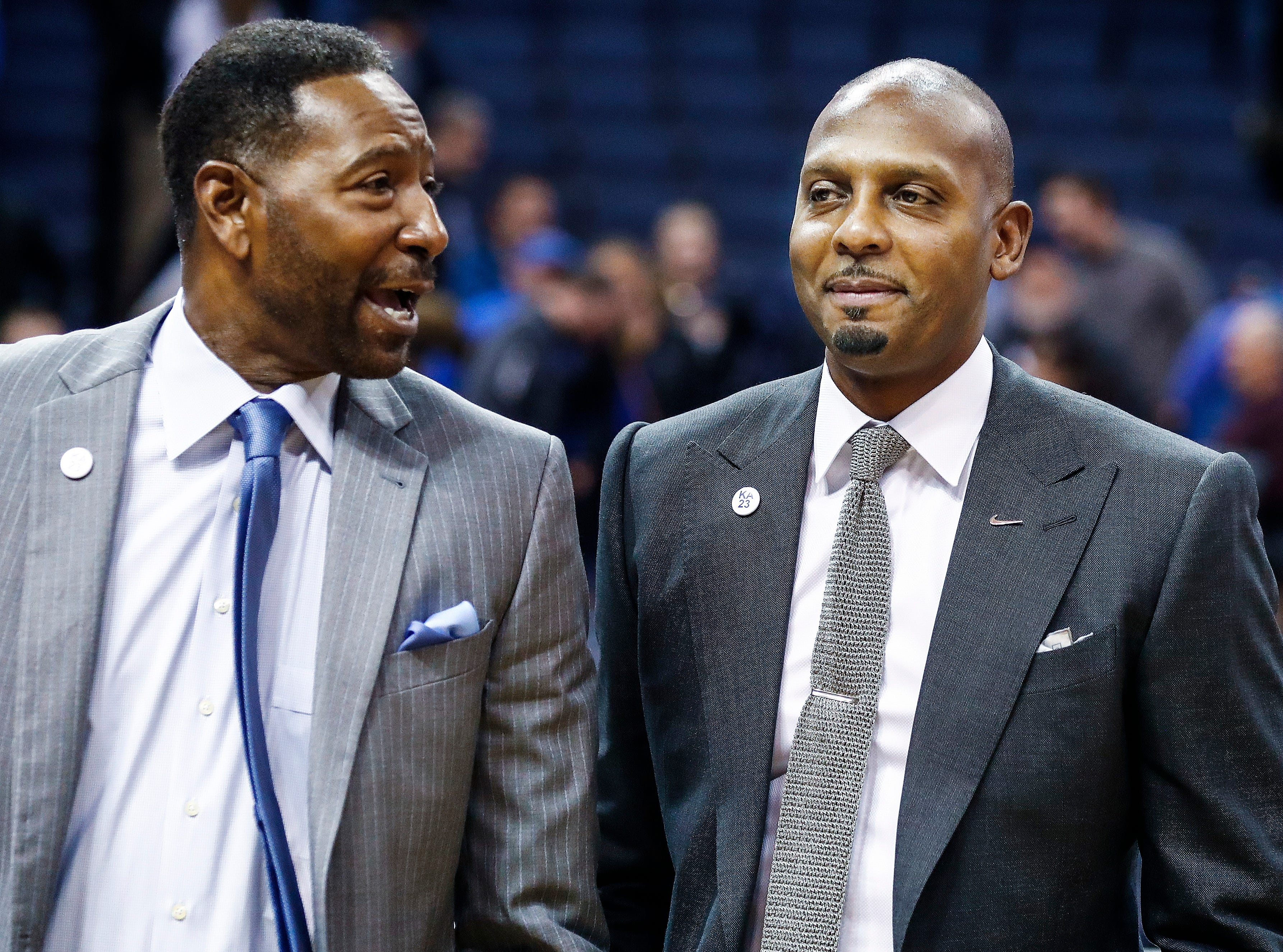 Memphis head coach Penny Hardaway (right) and assistant coach Sam Mitchell (left) smile as they walk-off the court after defeating ECU at the FedExForum, Thursday, January 10, 2019.
