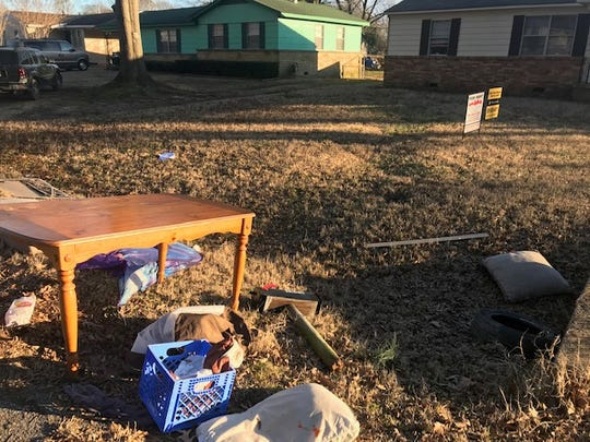 Furniture and clothing from an apparent eviction sit along a curb on a street in the Whitehaven area. Memphis tops the nation in evictions, and the impact on children is brutal.
