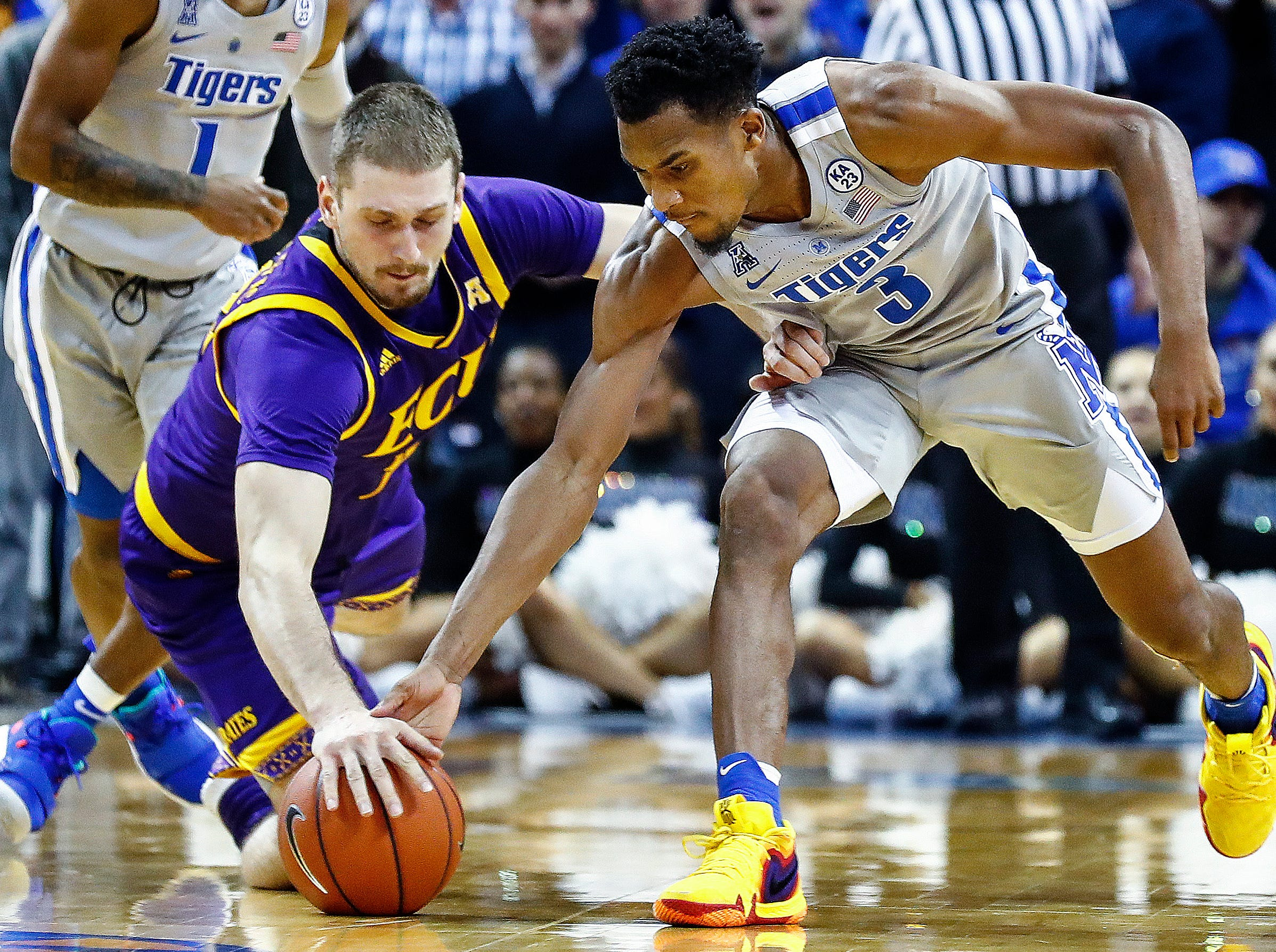 Memphis guard Jeremiah Martin (right) battles ECU forward Dimitrije Spasojevic (left) for a loose ball during action at the FedExForum, Thursday, January 10, 2019.
