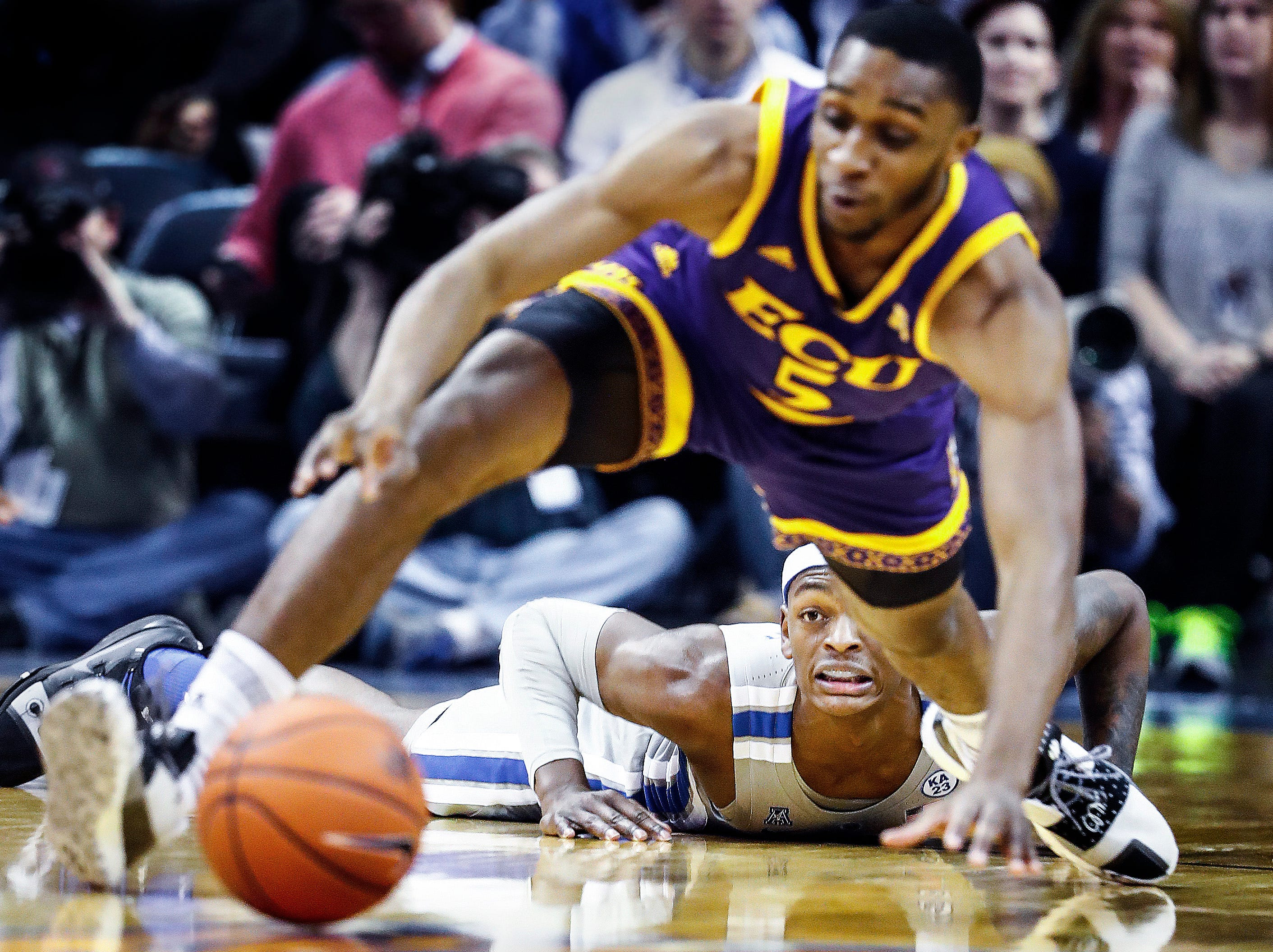 Memphis defender Kyvon Davenport (bottom) looks on as a loose ball rolls to ECU during action at the FedExForum, Thursday, January 10, 2019.