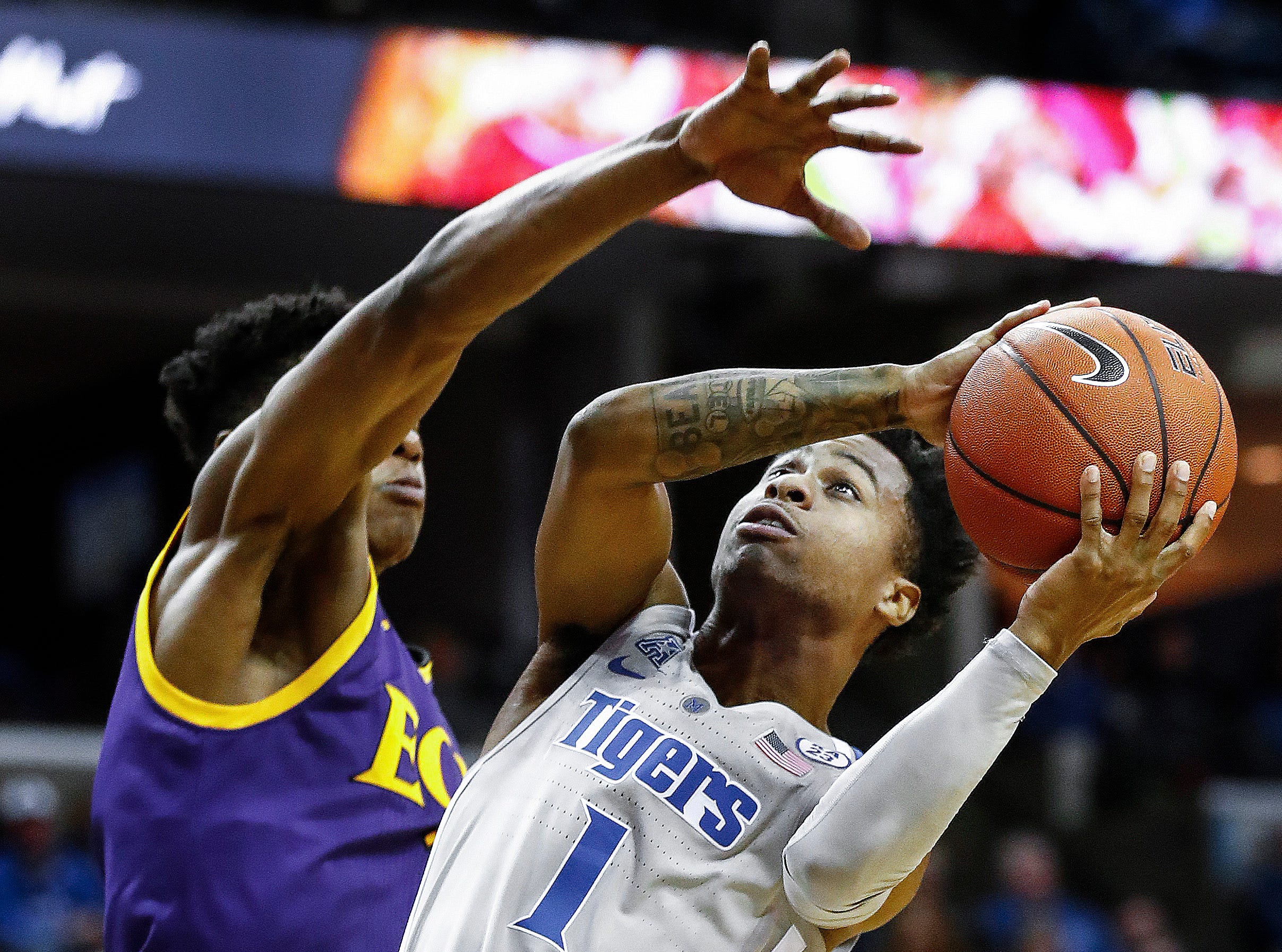 Memphis guard Tyler Harris (right) drives to the basket against the ECU defense during action at the FedExForum, Thursday, January 10, 2019.