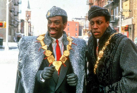 "Eddie Murphy and Arsenio Hall in ""Coming to America."""